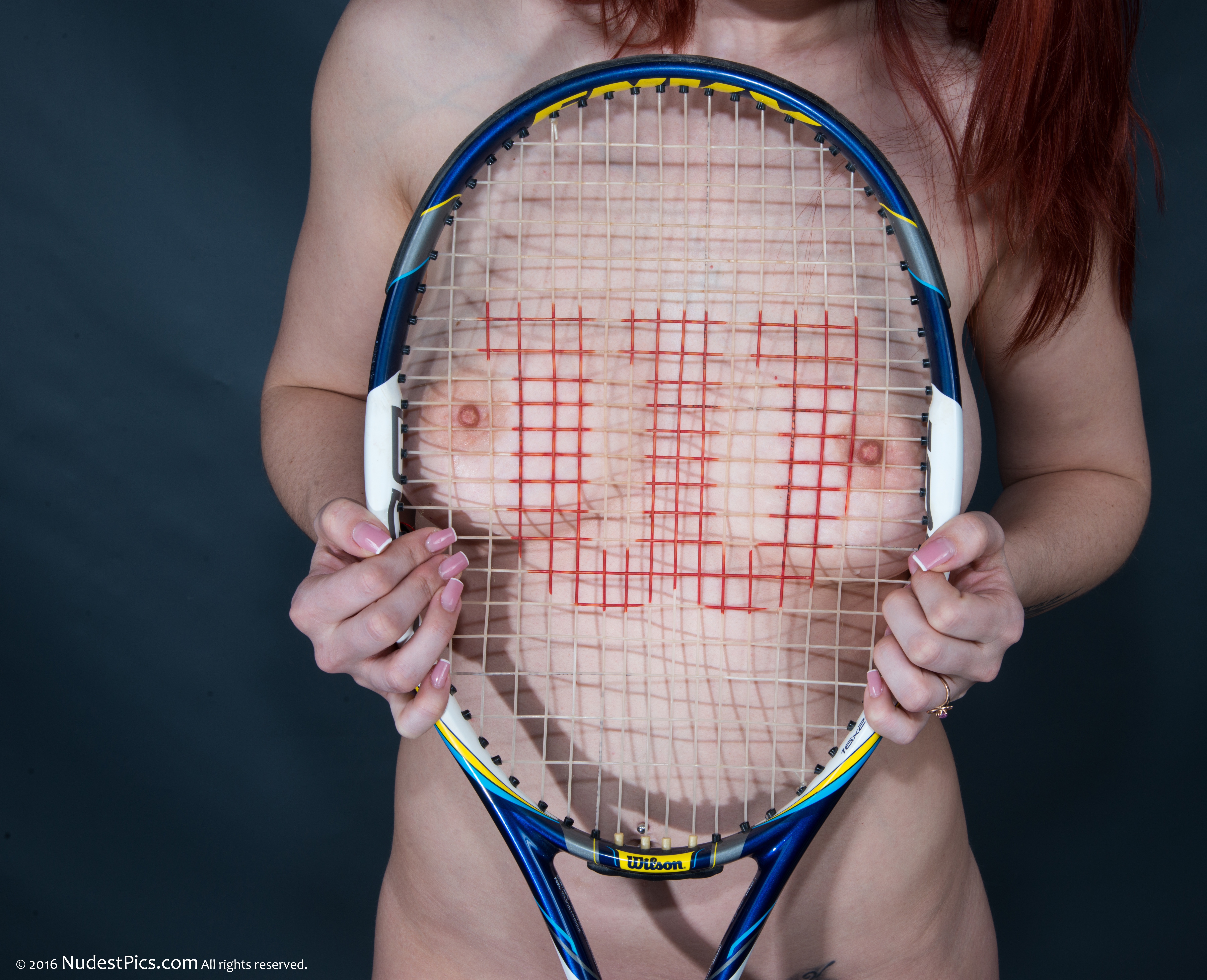 Tennis Racket Pressing on Breasts HD