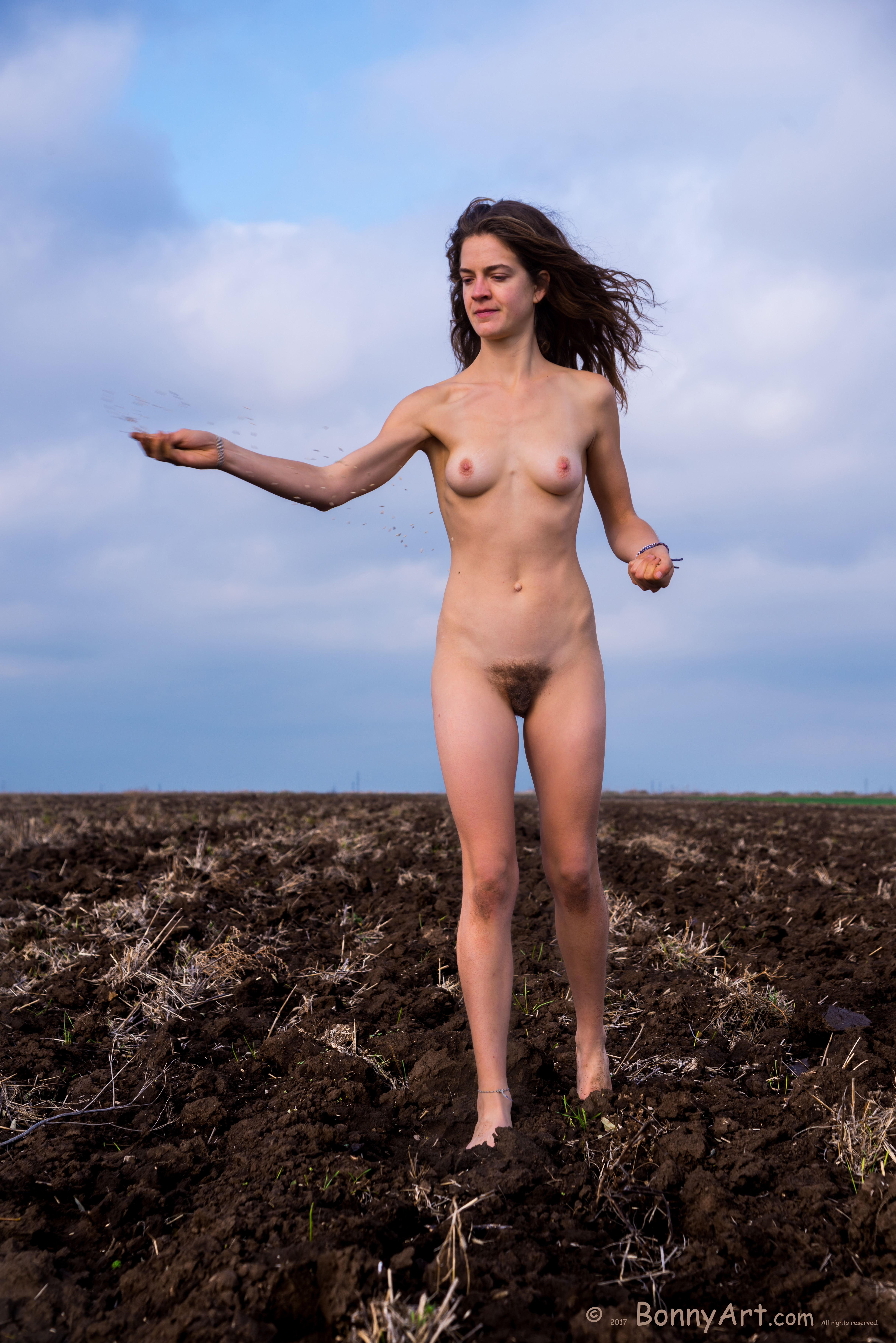 Nude Woman Sowing Wheat in the Field HD