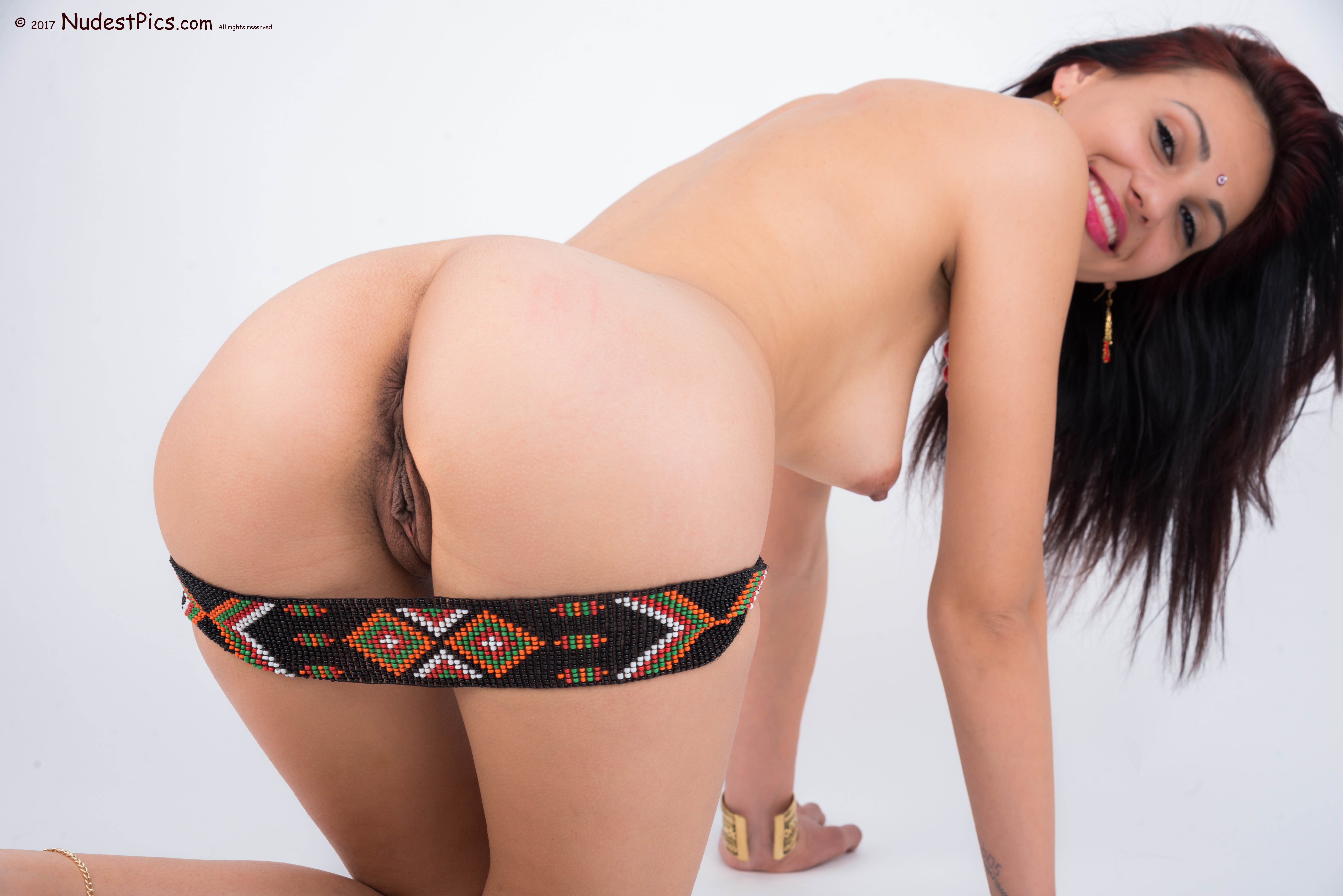 On all fours Naked Gal with Indian Belt