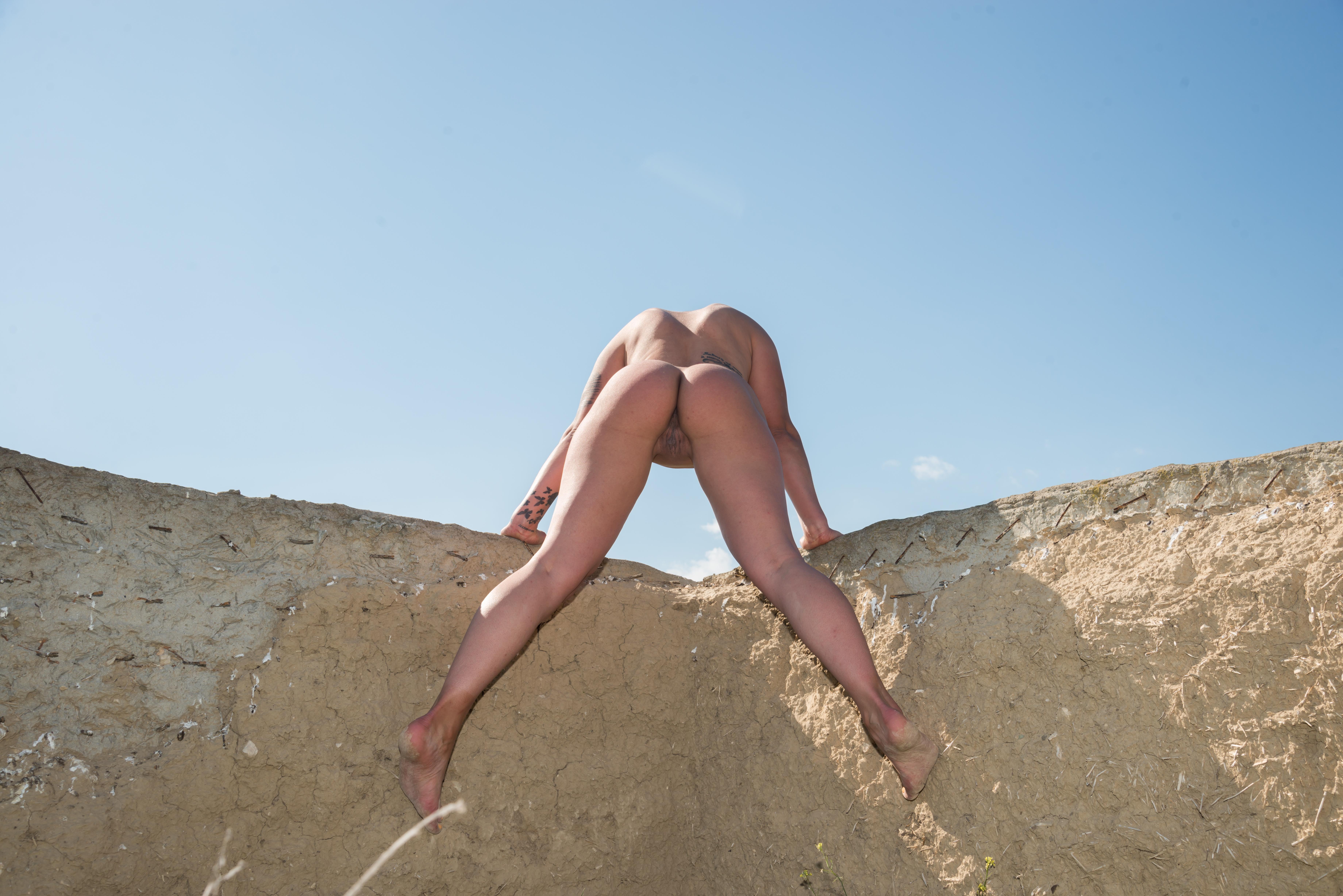 Country Girl Naked Gymnastics on Mud Wall