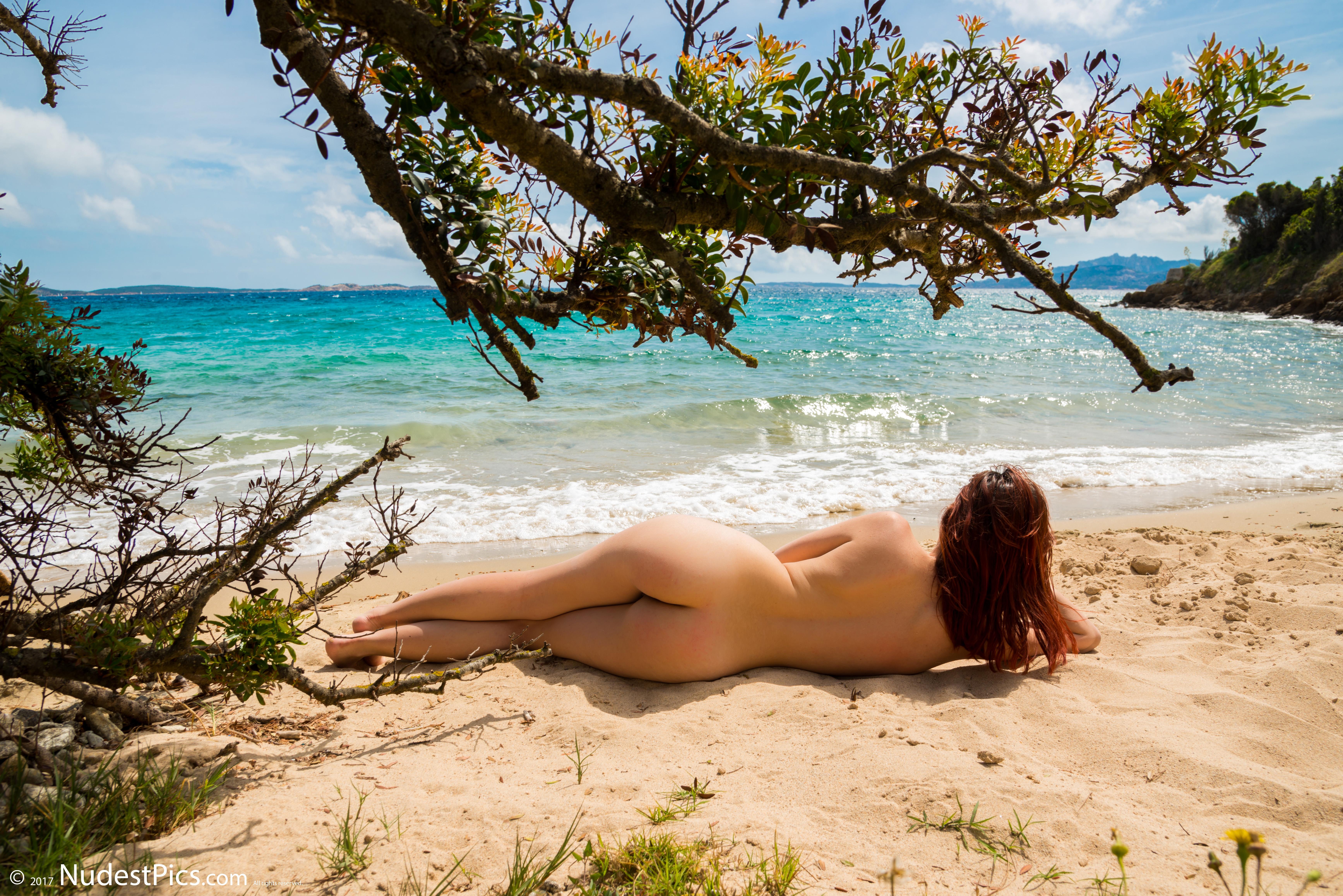 Woman Sunbathing on Nudist Beach HD