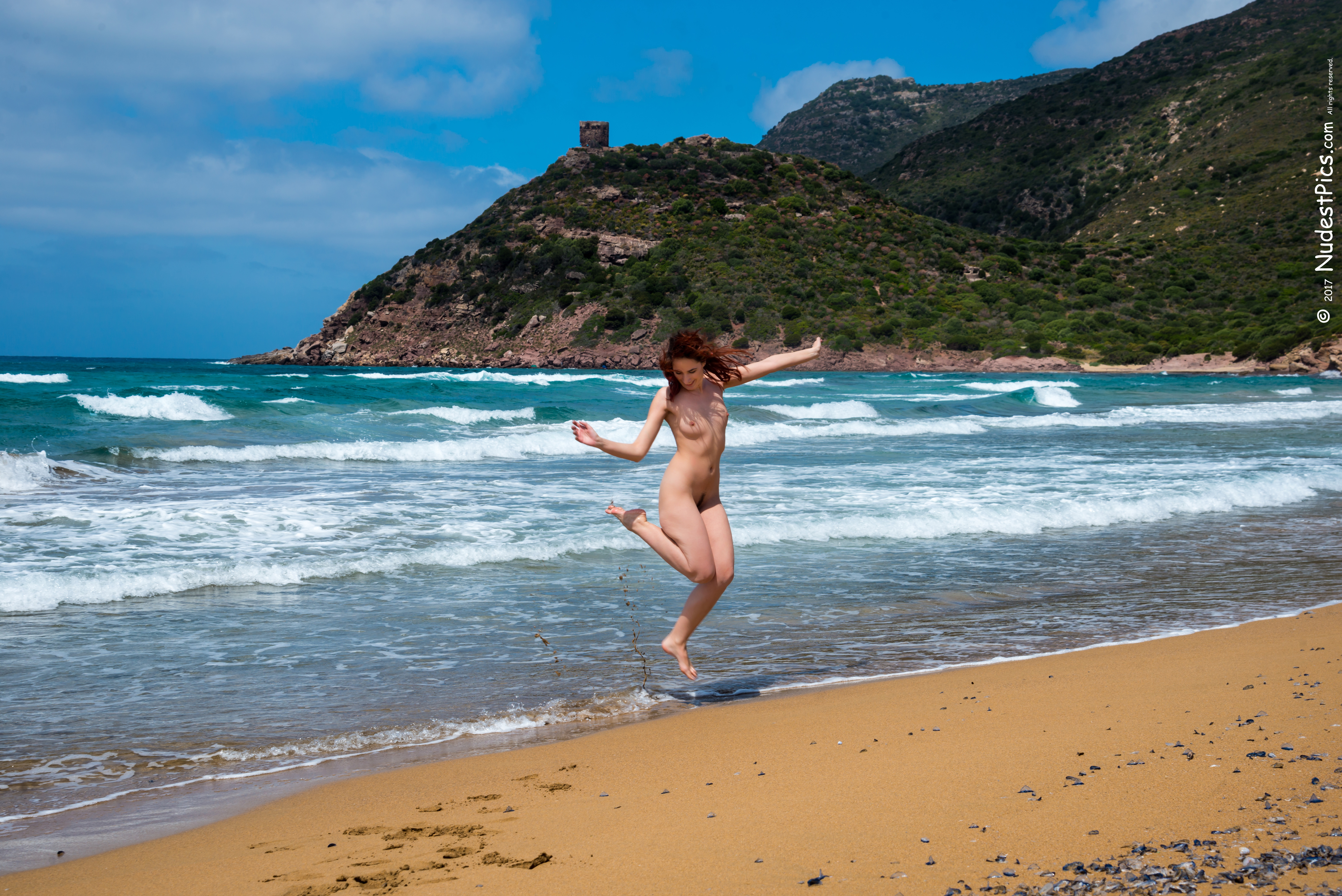 Candid Nudist Girl Jumping on the Beach