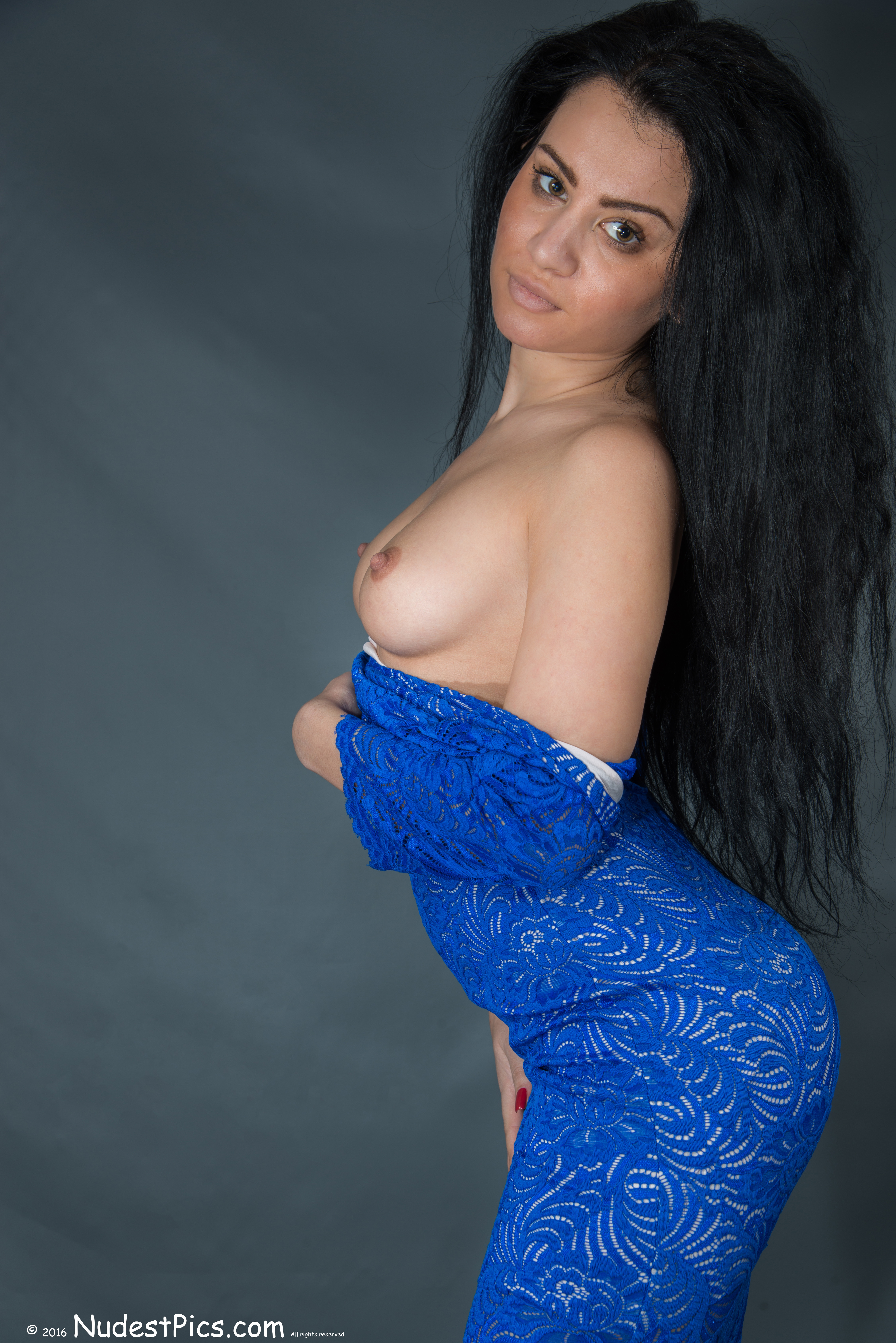 Long Haired American Latina Brunette Exposing Breasts