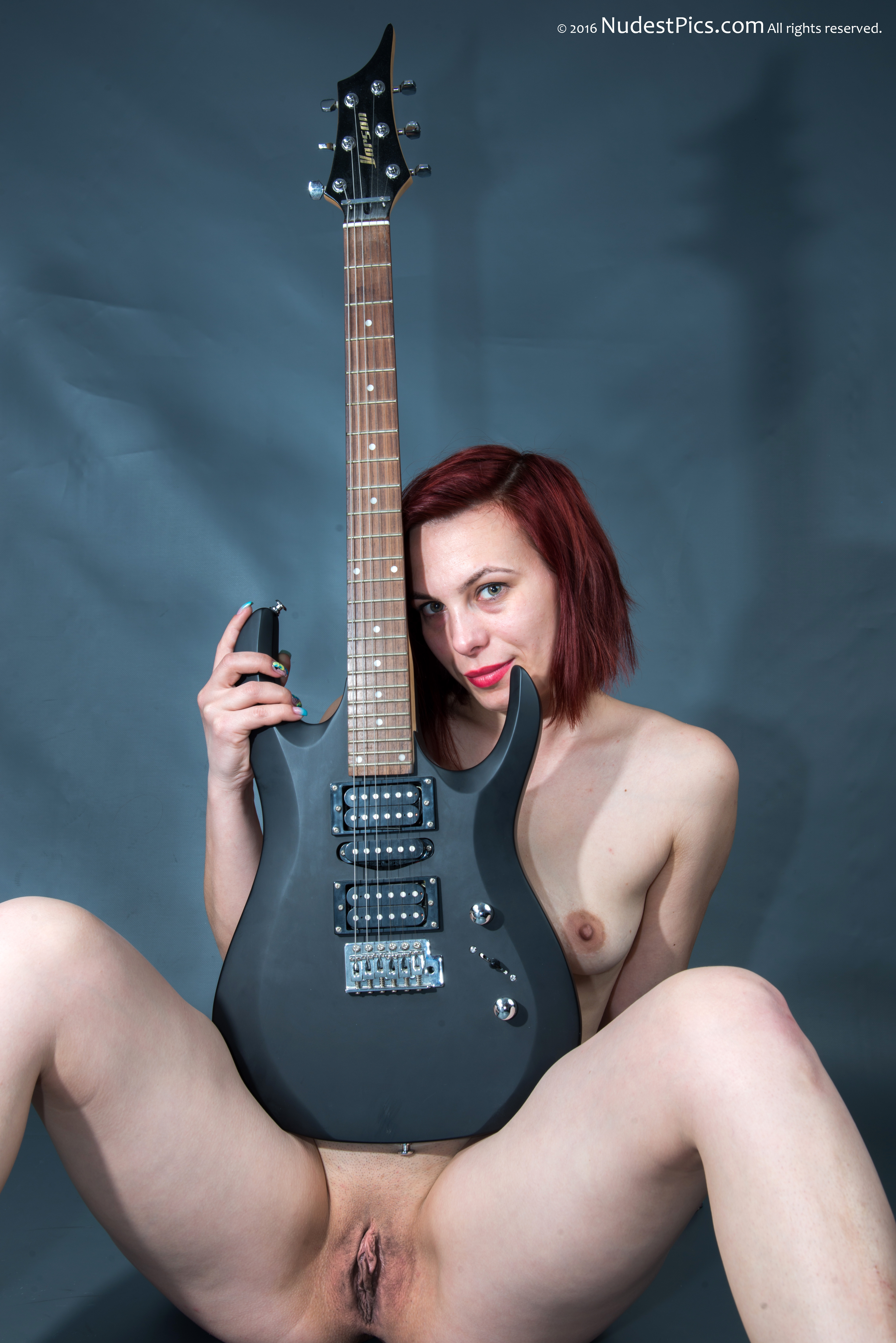 Redhead Nude Canadian Girl with Electric Guitar
