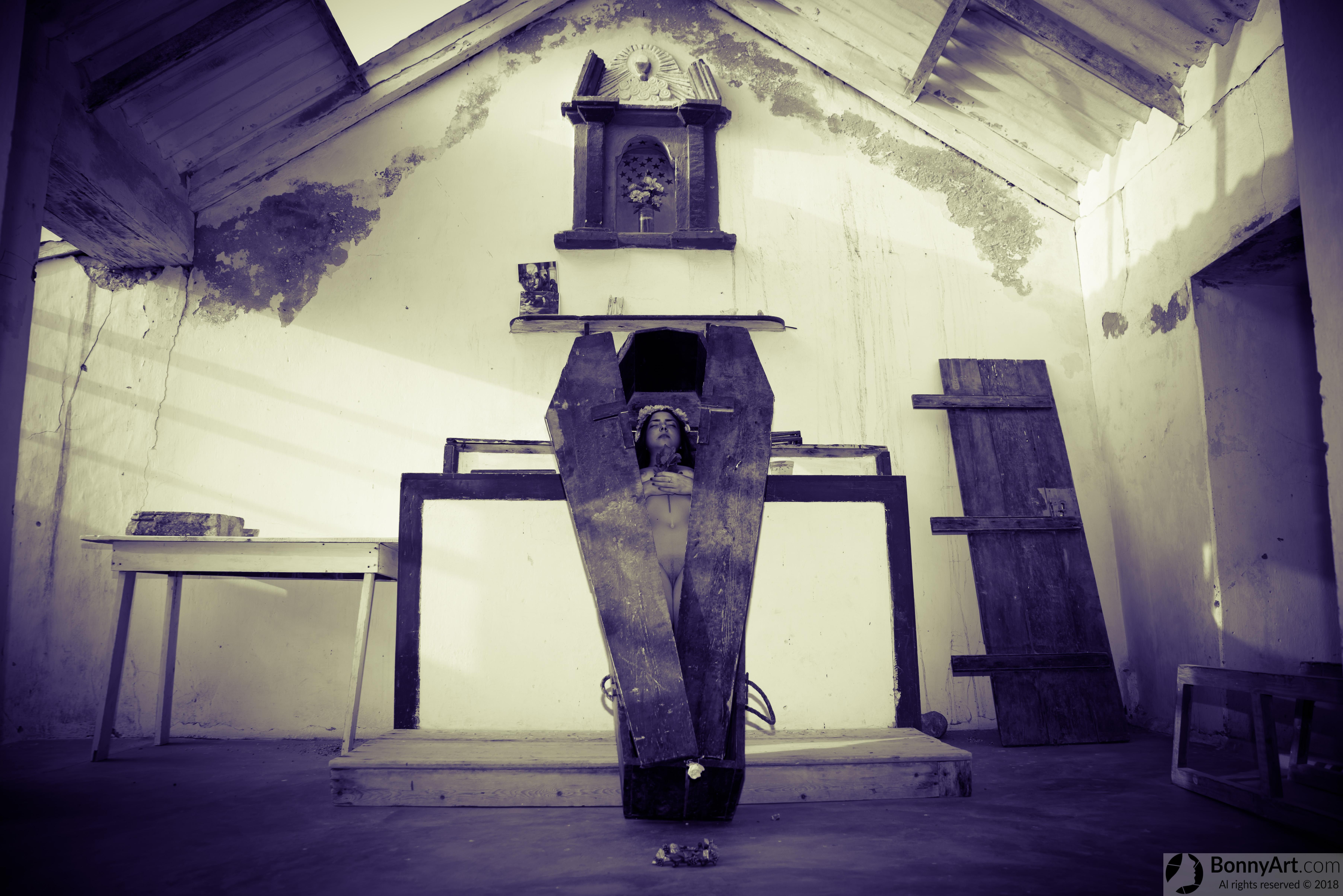 Dead Girl Nude in the Coffin inside Chapel