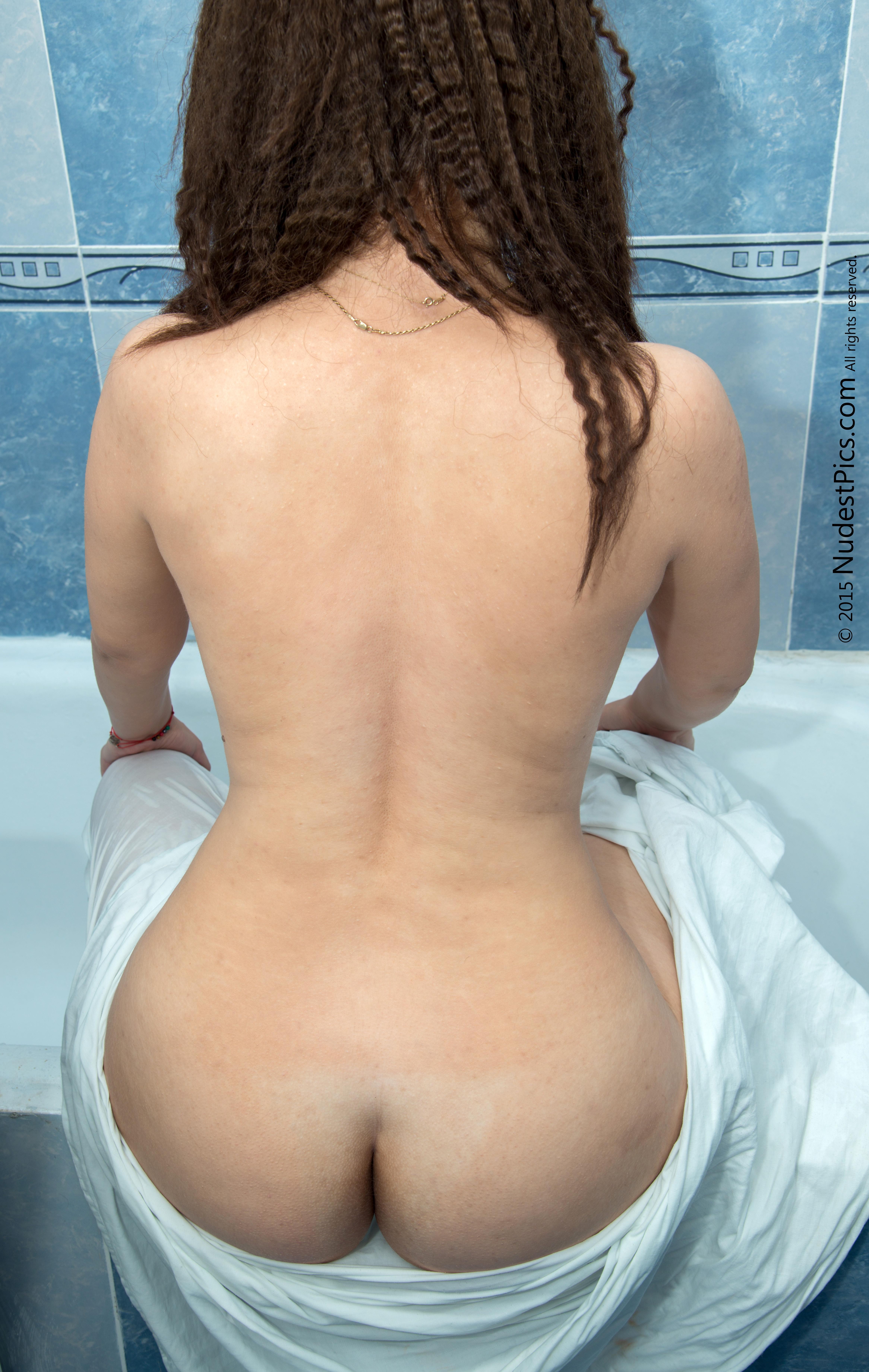Naked Girl Back Round Booty Sitting on Bathtub