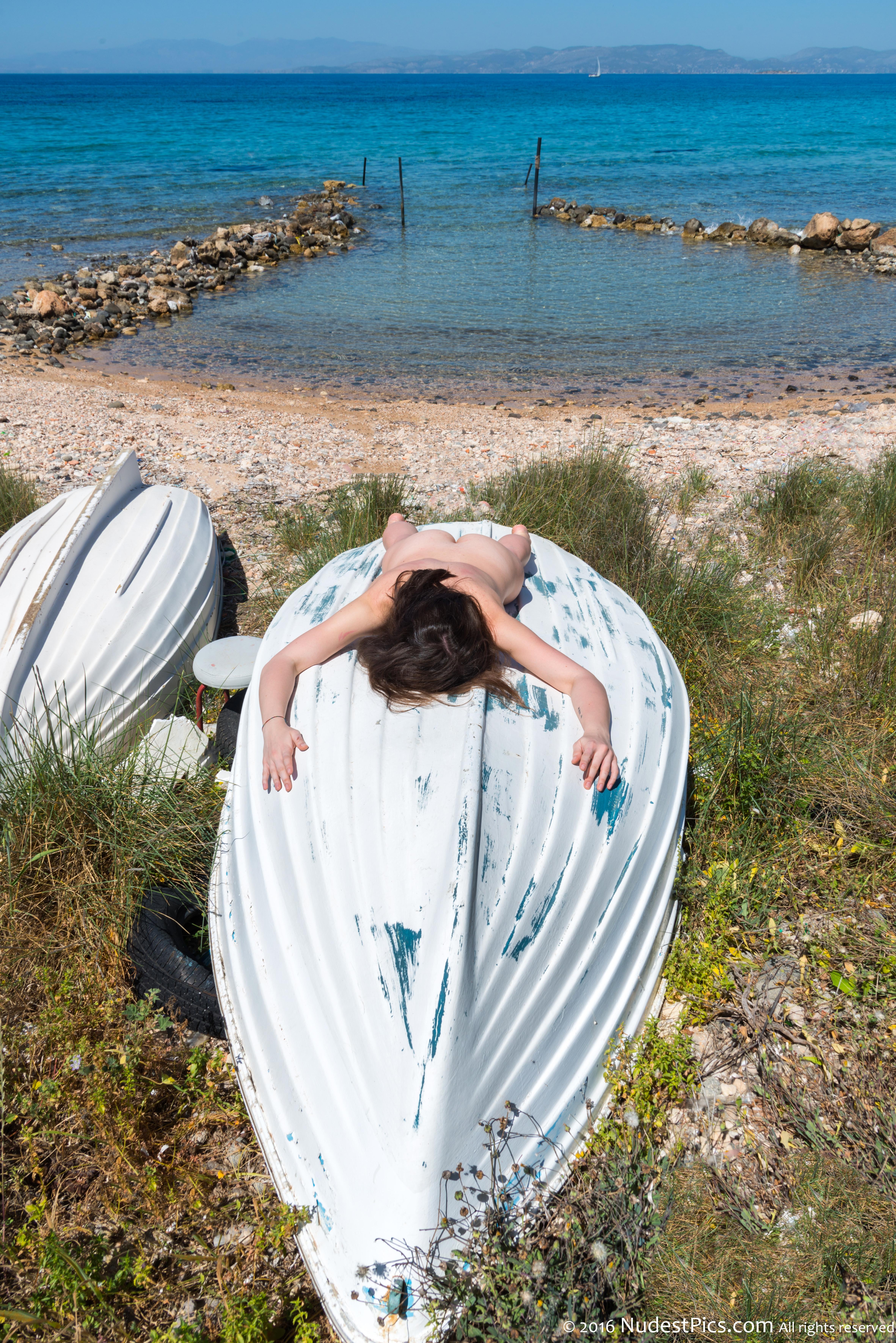 Nudist Woman Sunbathing on Boat at Seaside