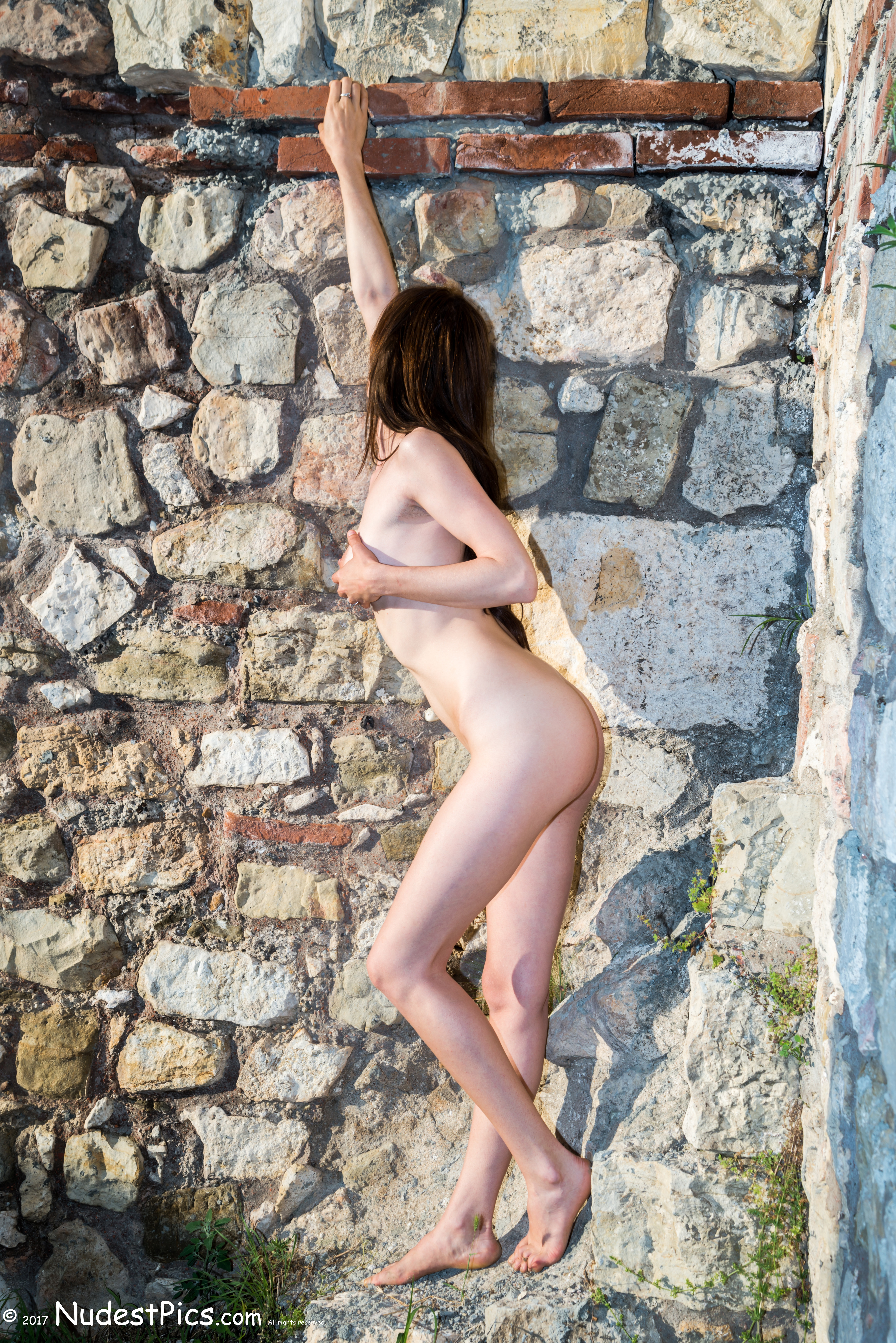 Thin Girl's Body at the Stone Wall nude HD