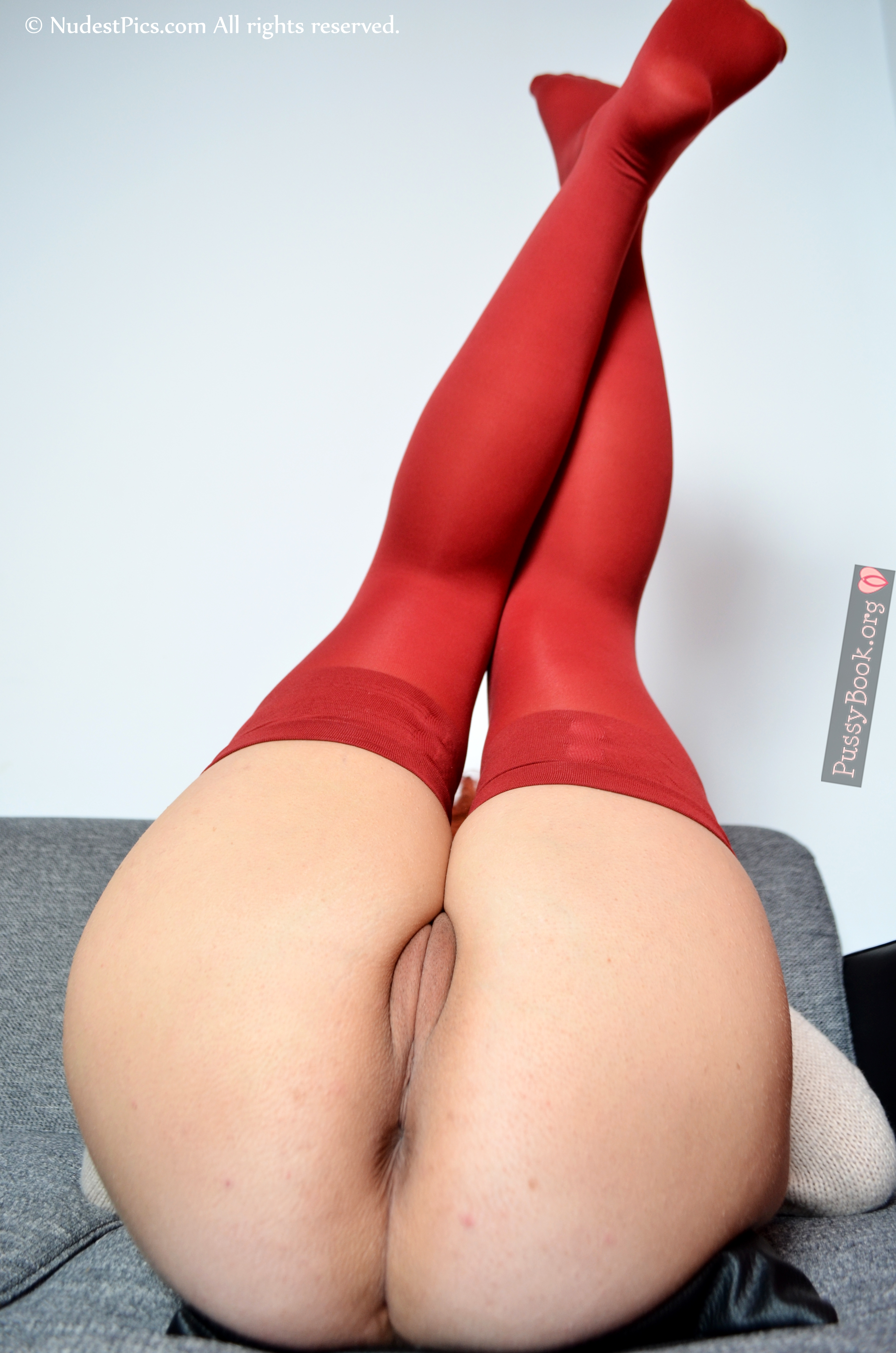 Beautiful Erotic Pussy Legs Up Red Stockings