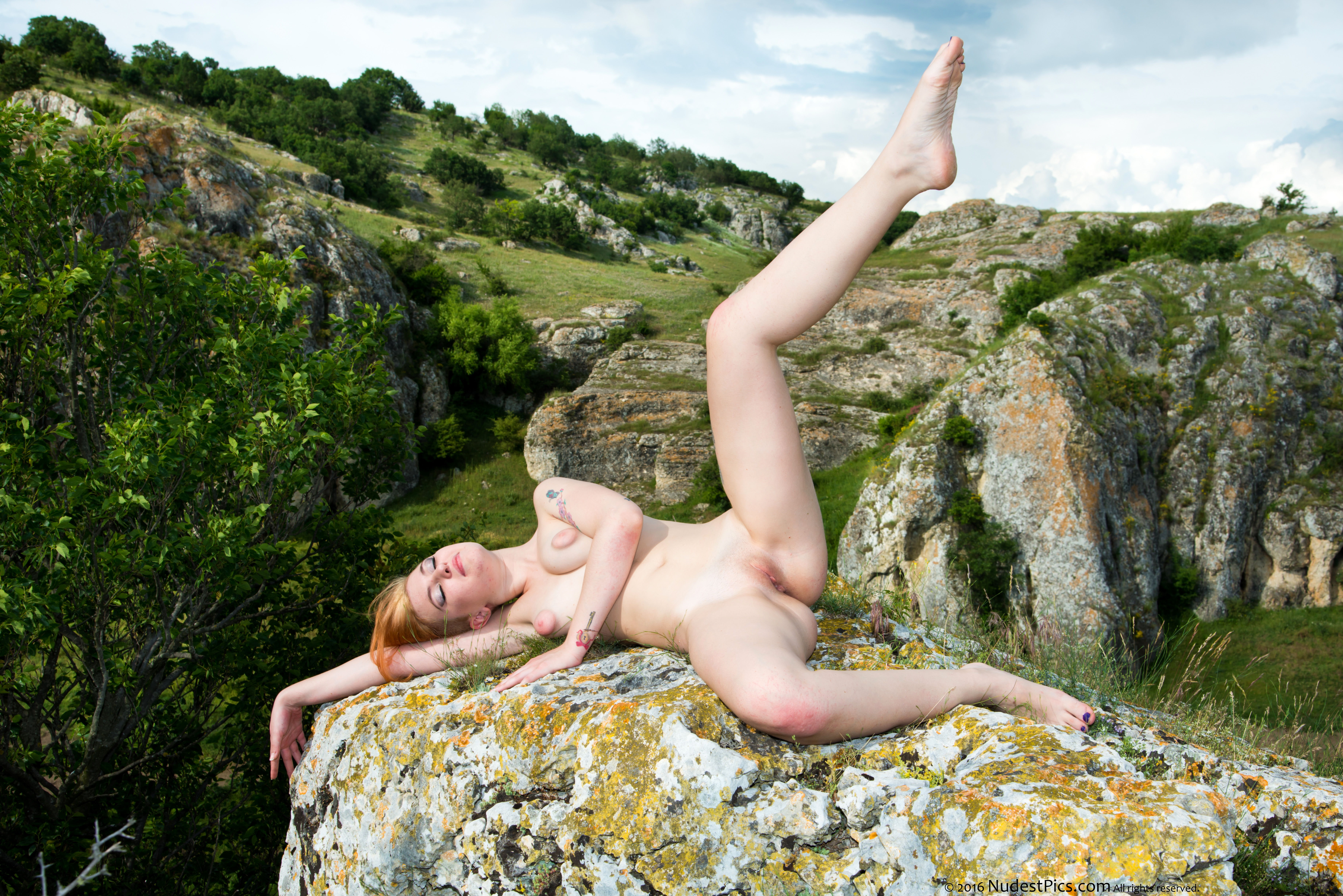 Naked Yoga Girl Legs open of a Cliff HD