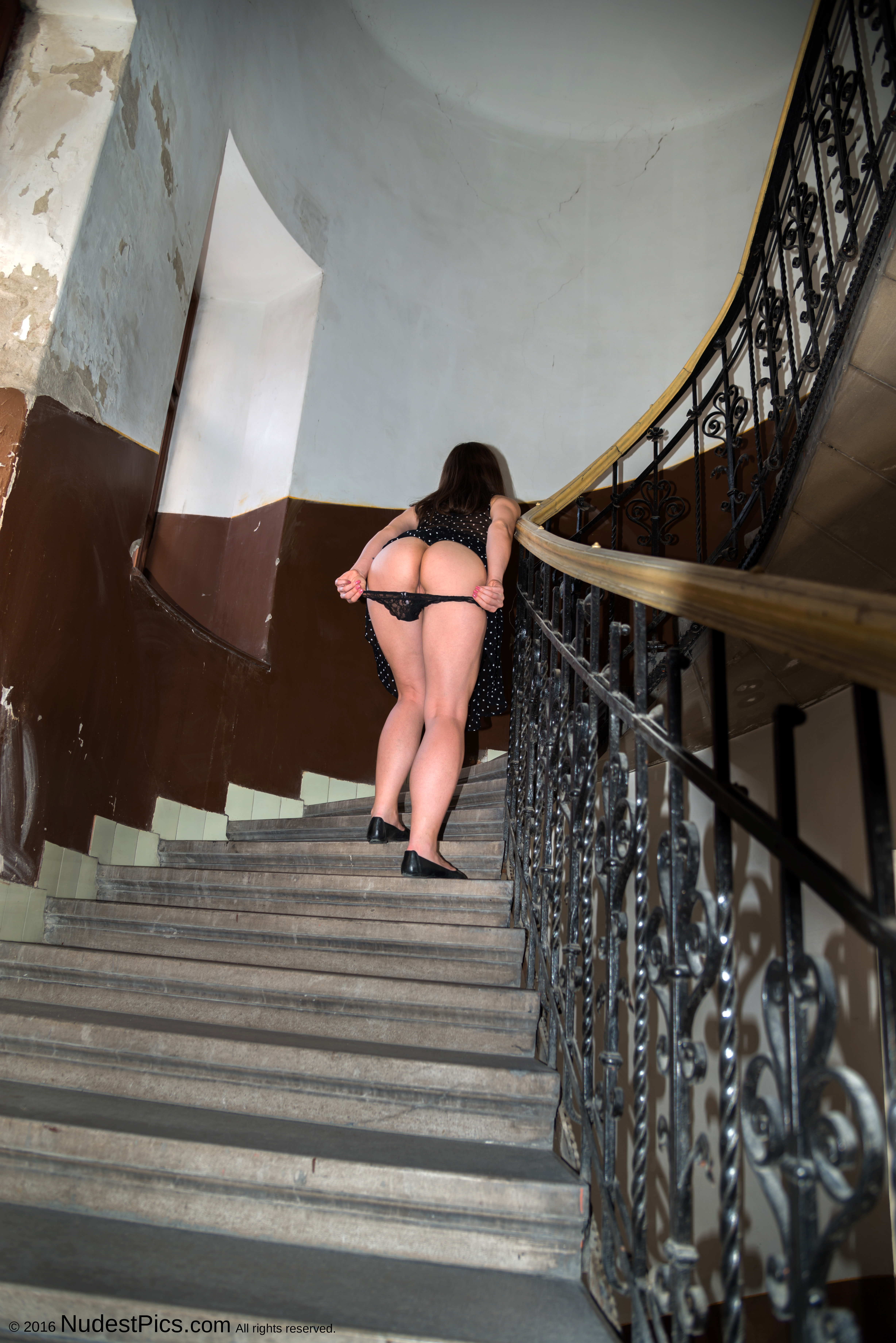 Flashing Round Buttocks Old Building's Grand Stairs