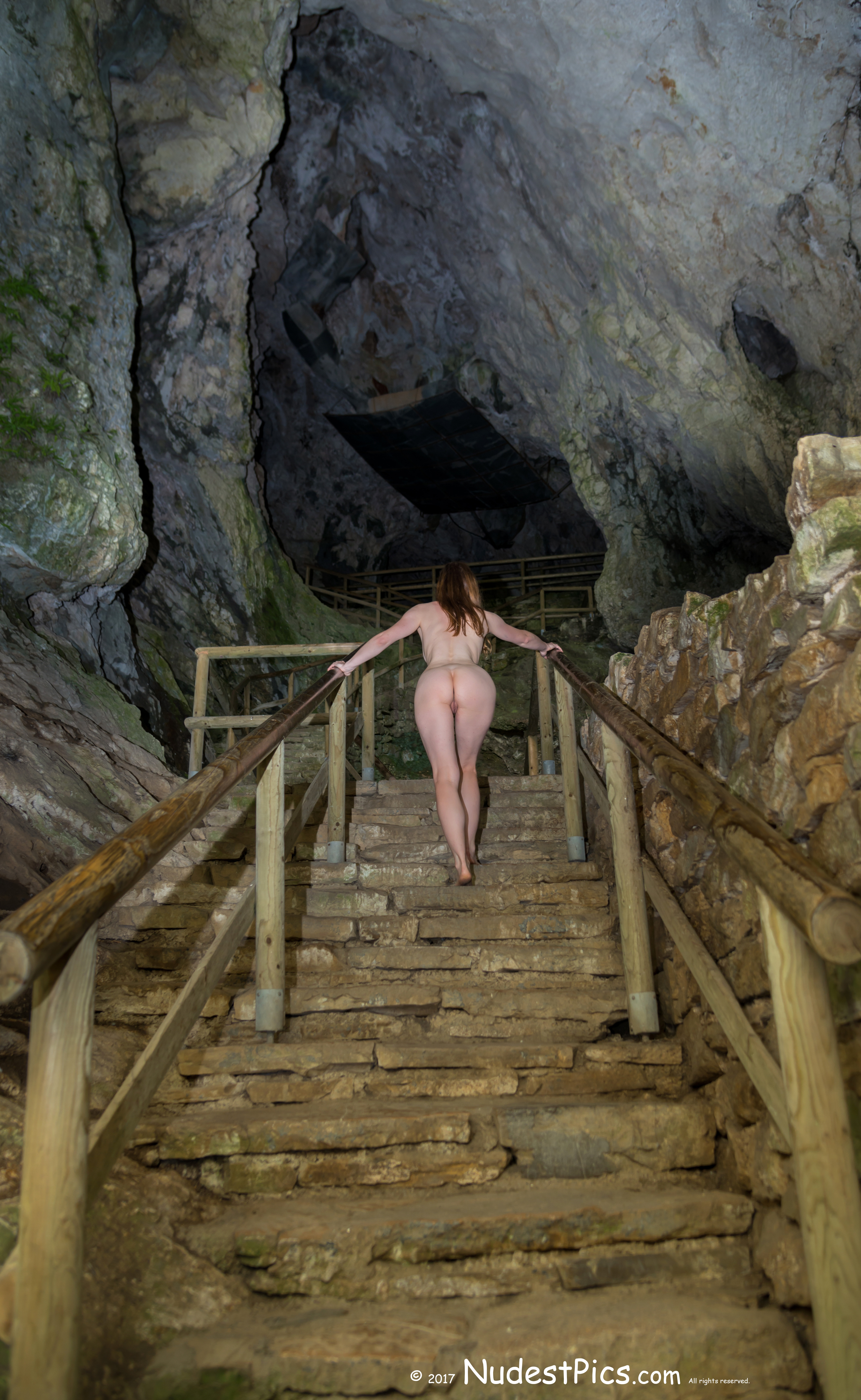 Nude Girl Climbing Stairs in a Cave HD