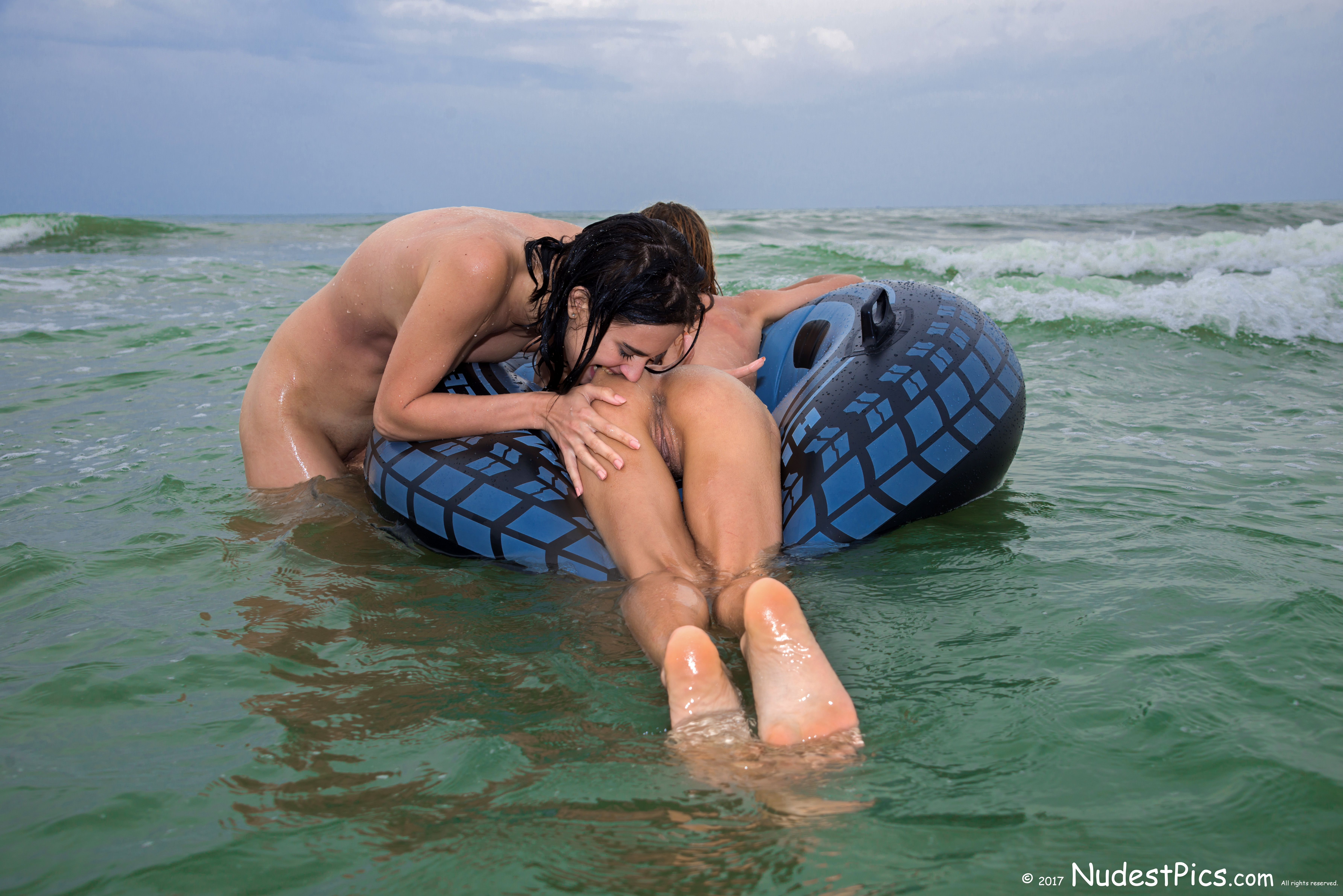 Wet Nudists Biting Butt on Life Buoy