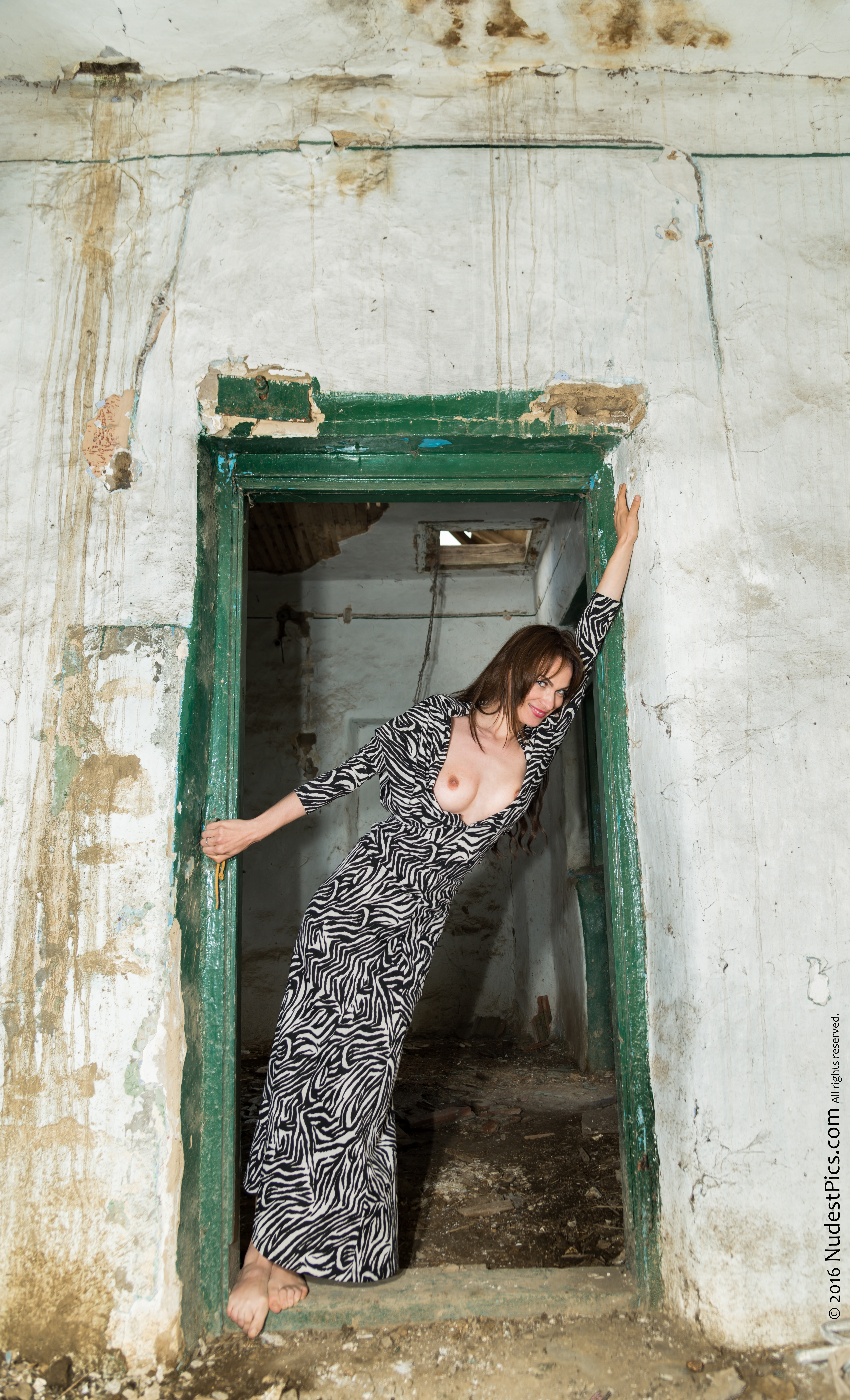 Tall Girl Popping Breast Out of Long Dress at Old Shed's Door