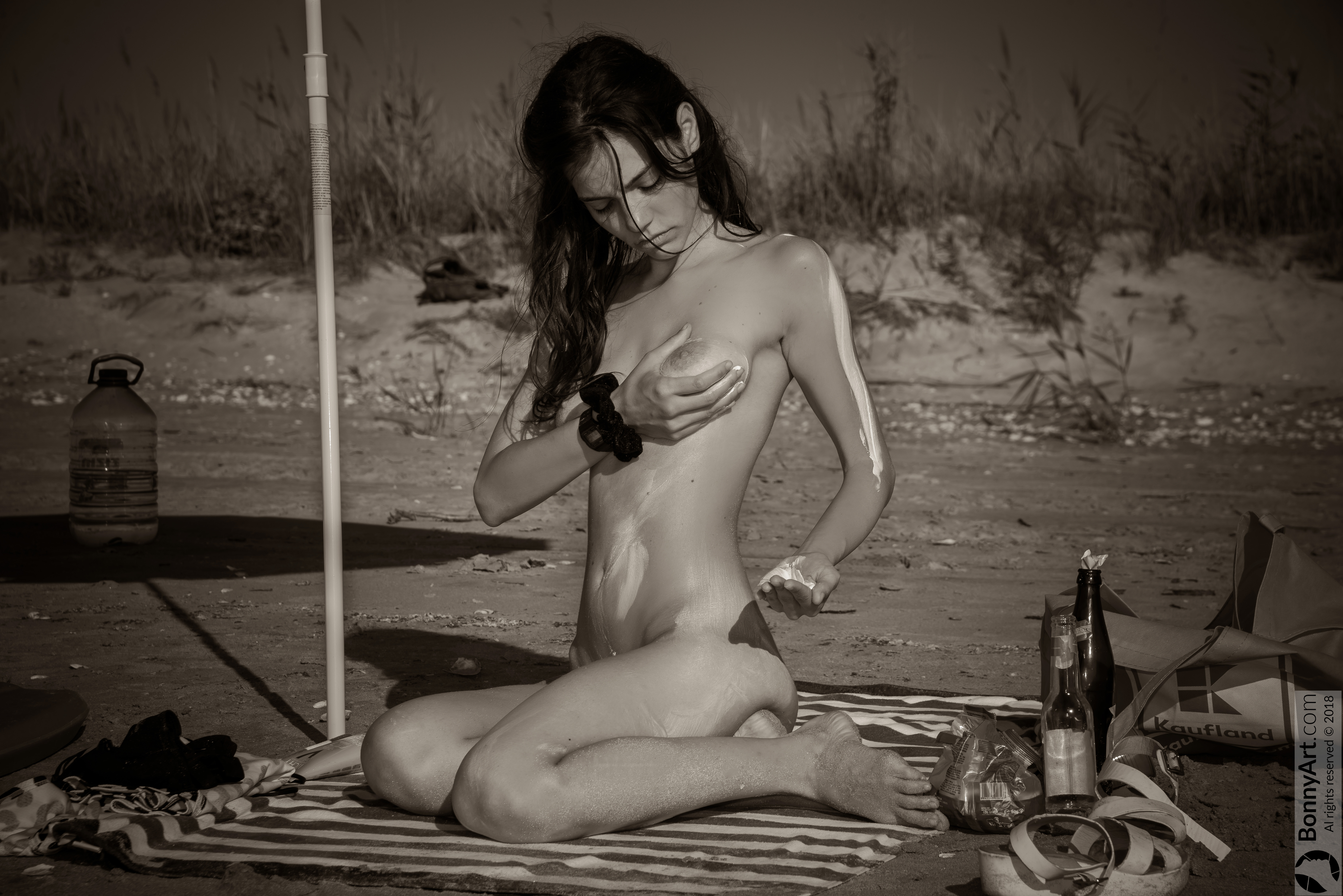 Vintage Nudist Beautiful Girl on Beach Using Sunscreen