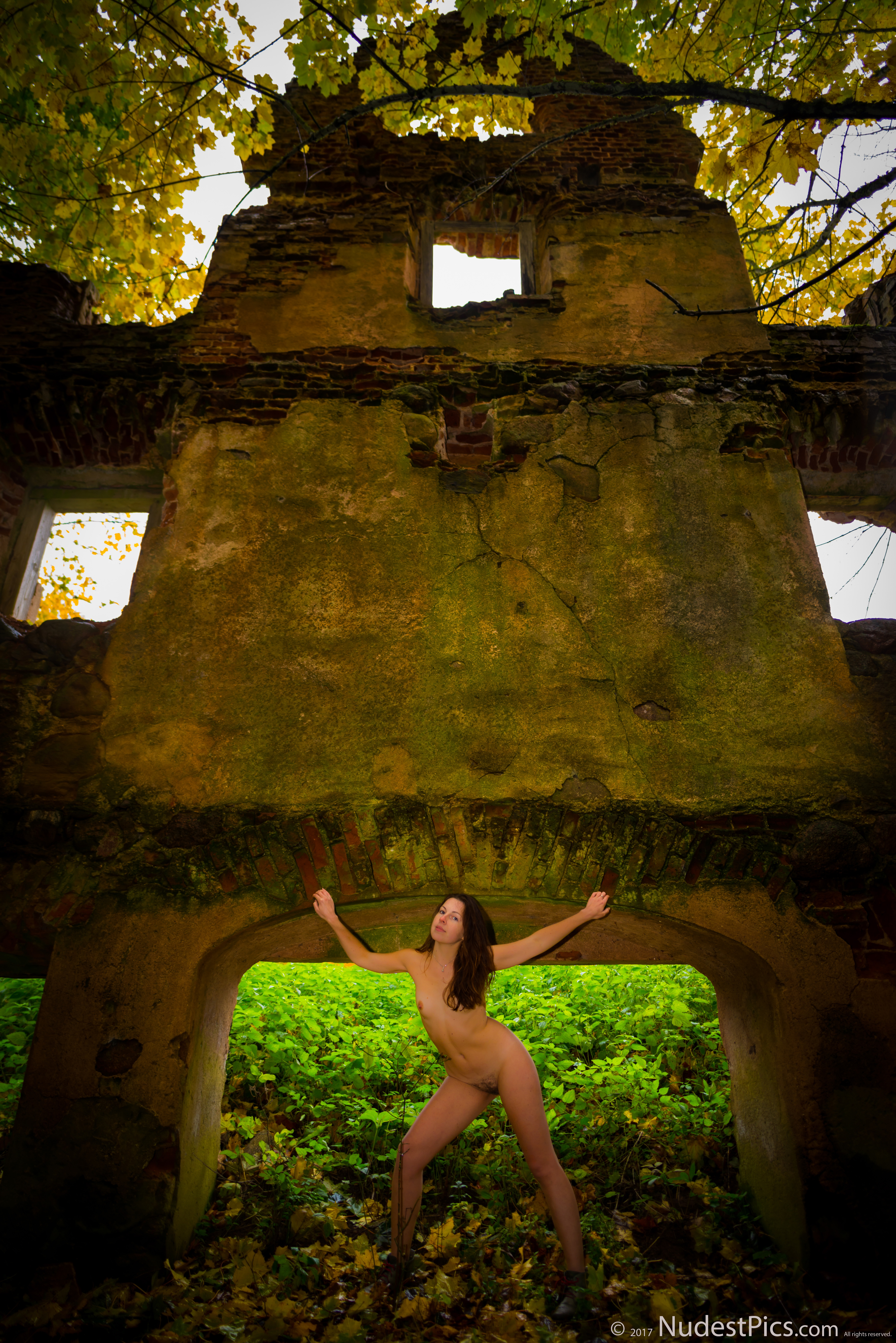 Nude Girl Posing at the Ruined Wall HD