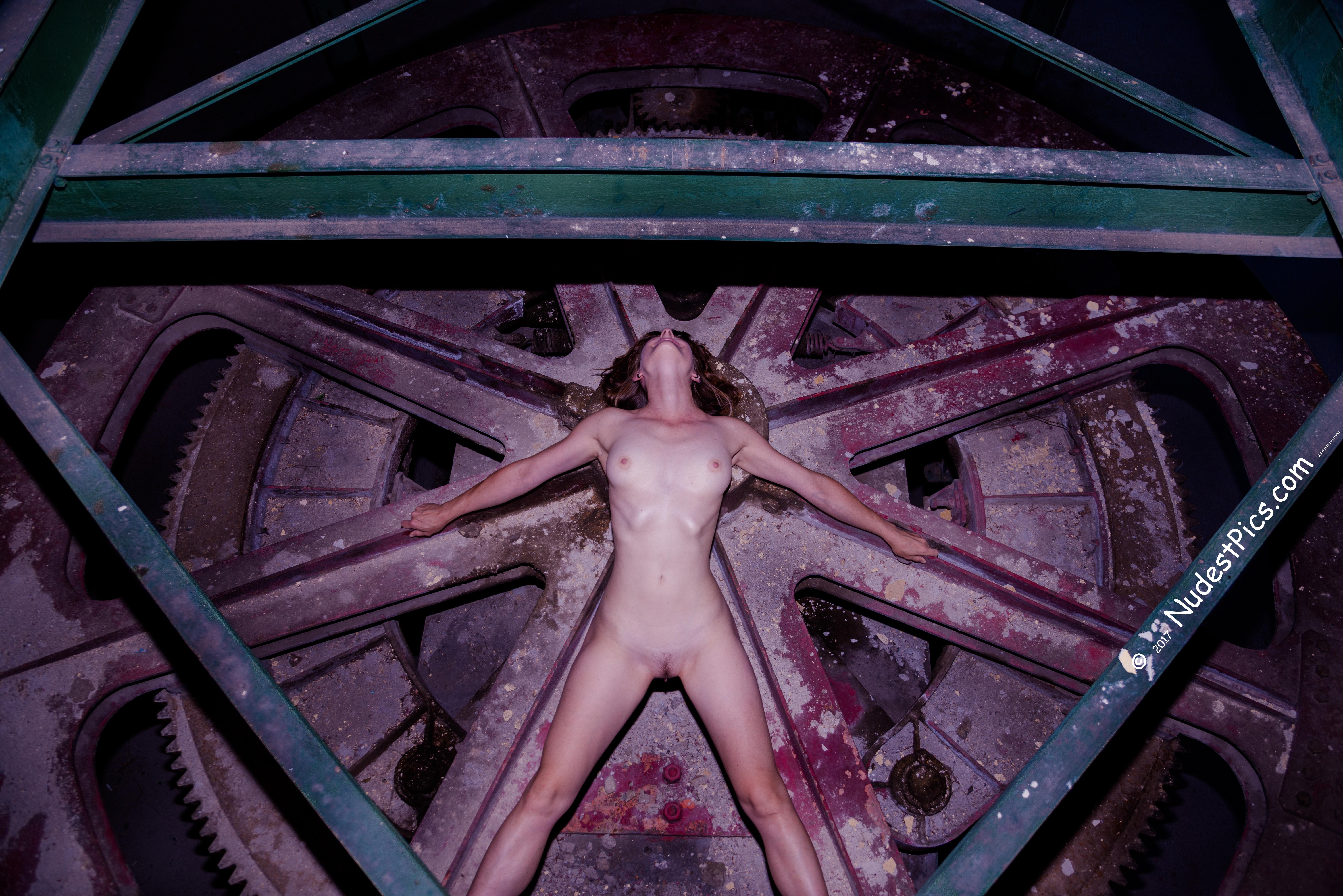 Naked girl bends over
