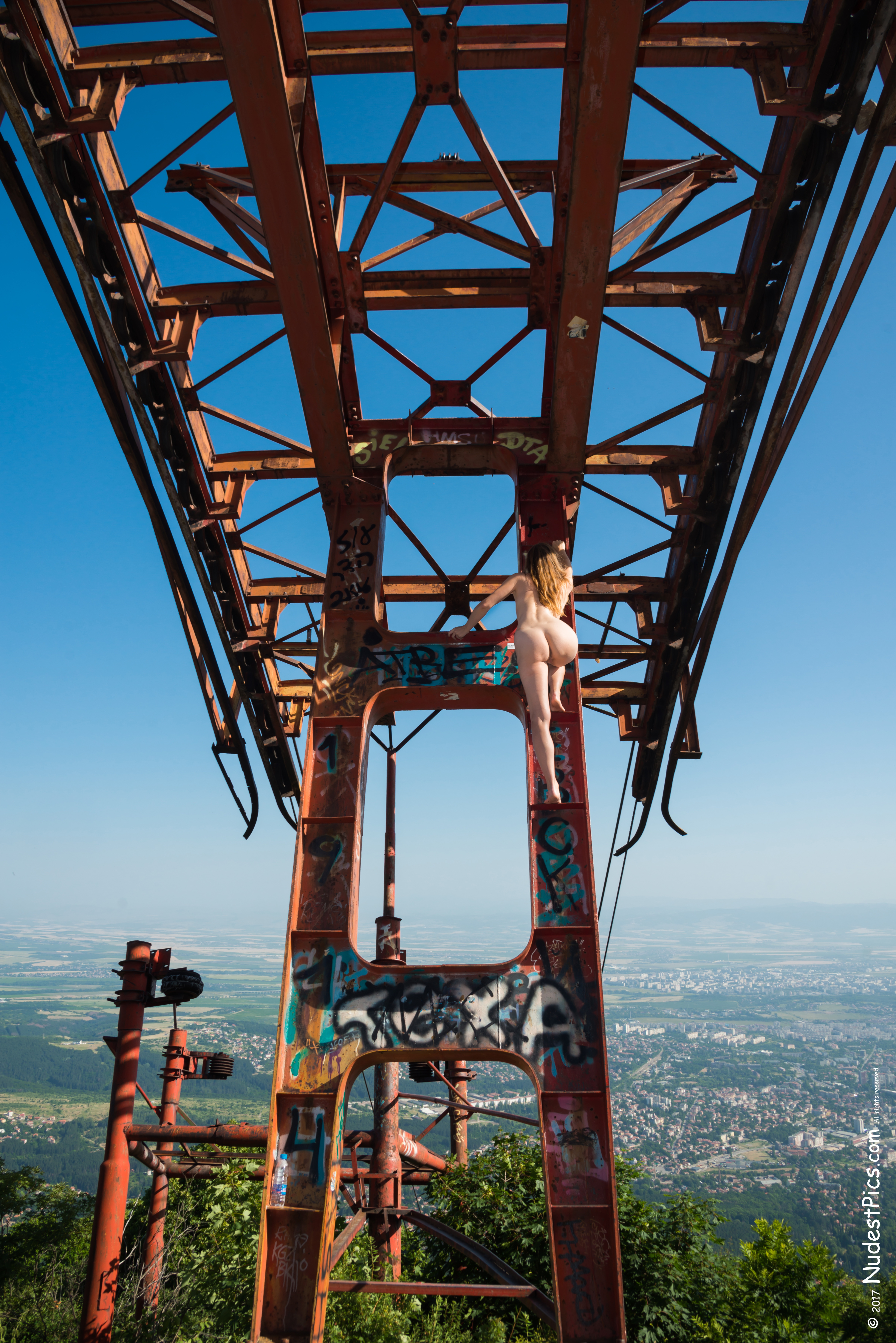 Fearless Naked Girl Climbing on Cable Car's Poles HD