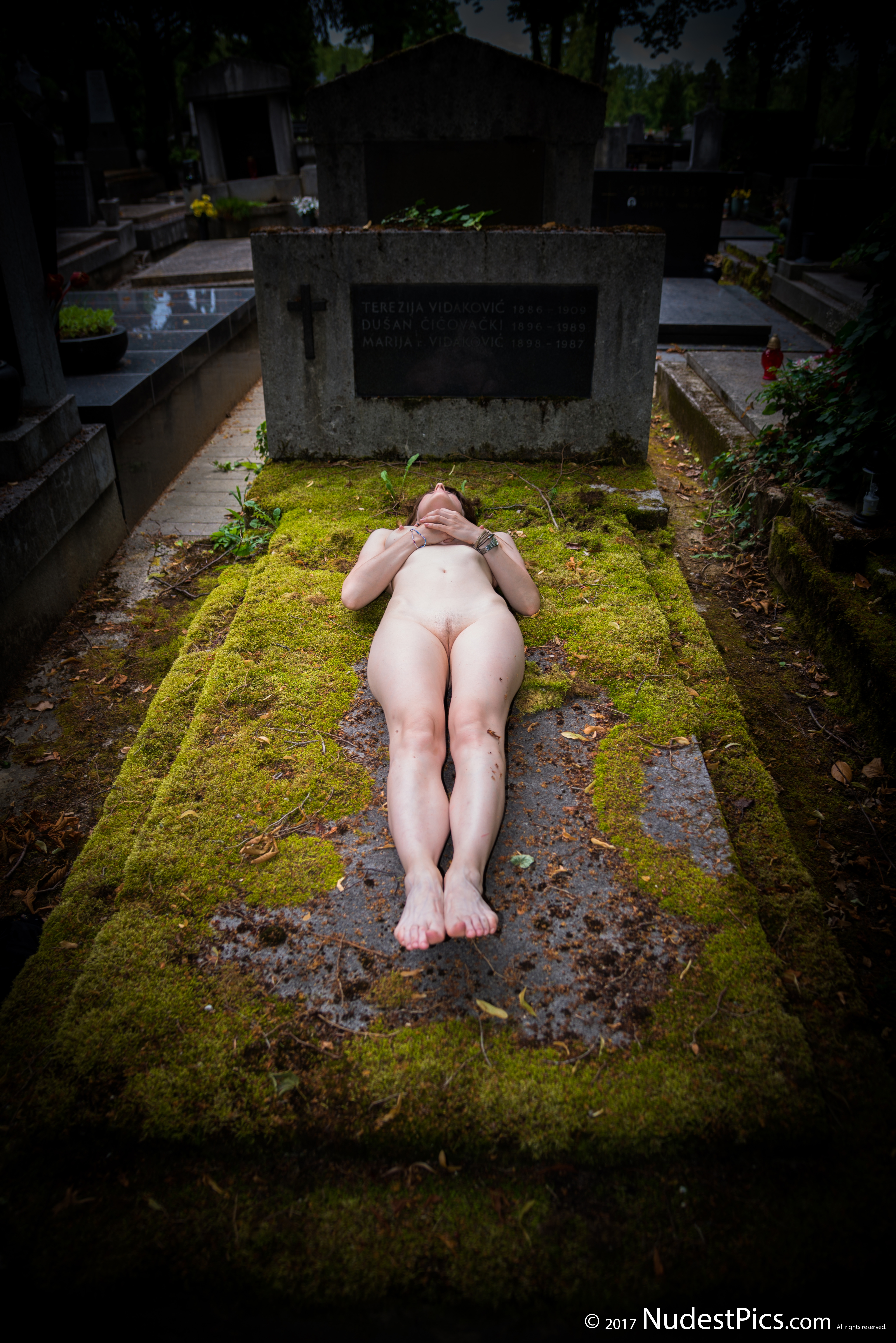 Naked Dead Girl on an Old Grave