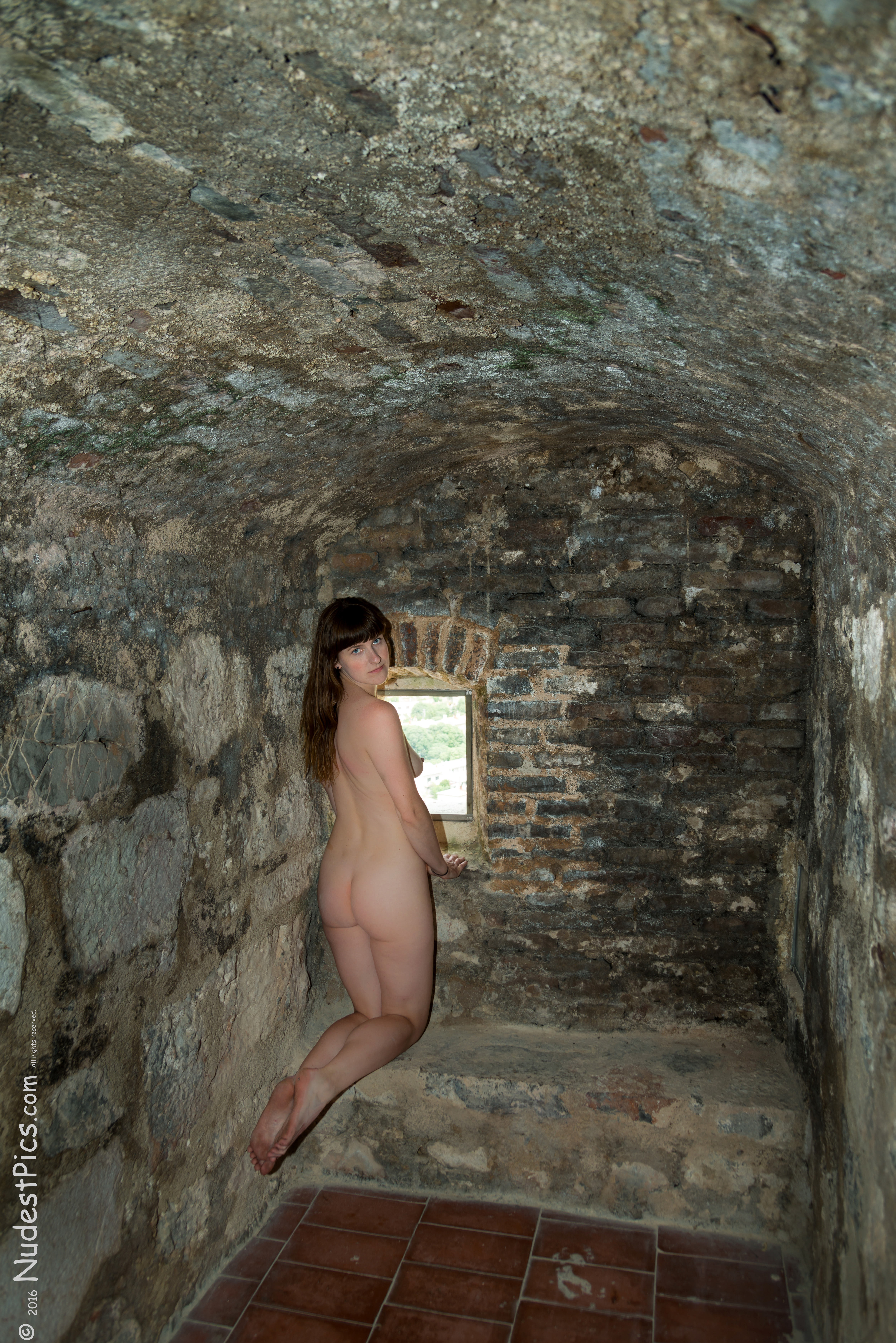 Naked Lady Kneeling in the Castle Cell HD
