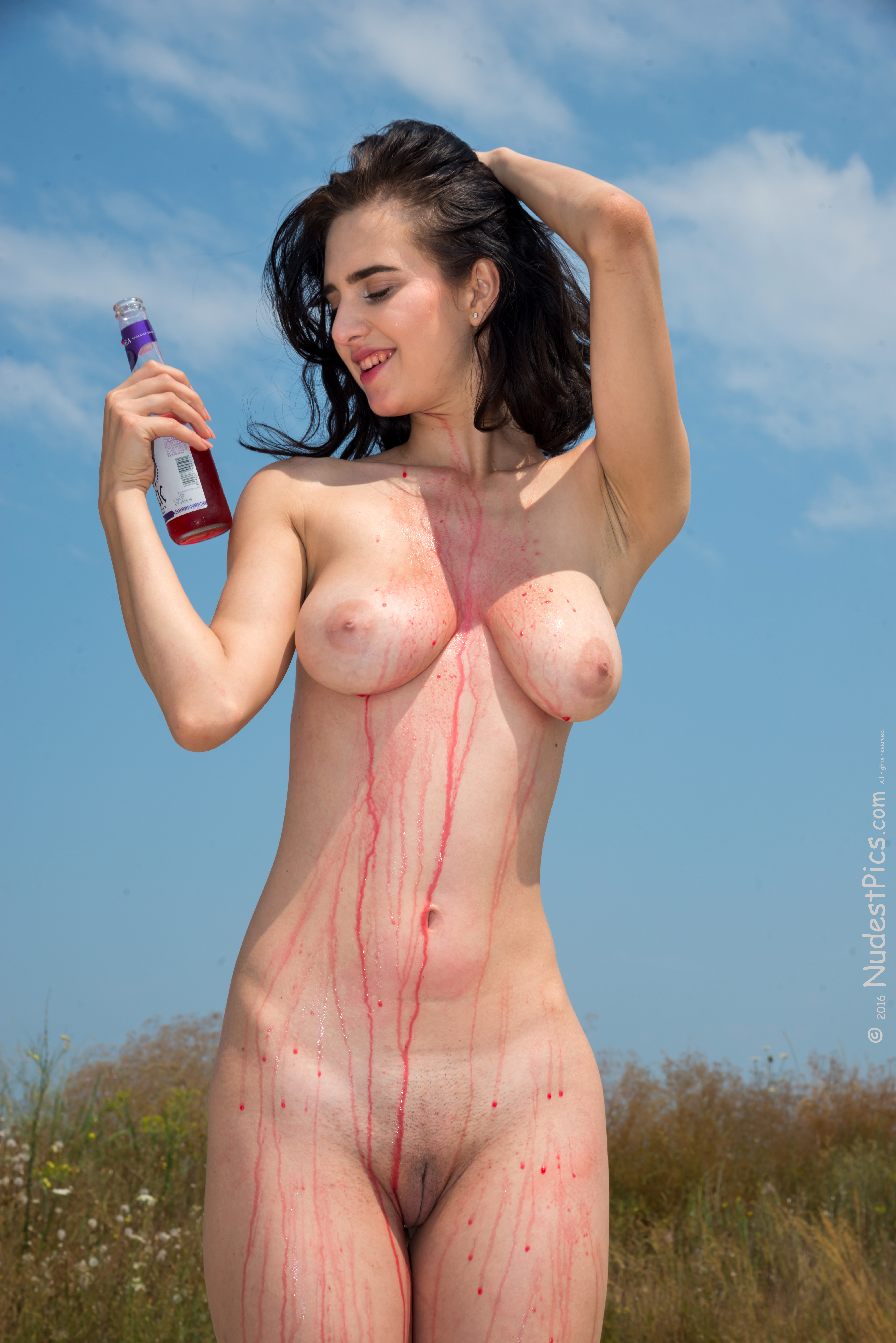 White Brunette Girl Spilling Red Drink on her Naked Body HD