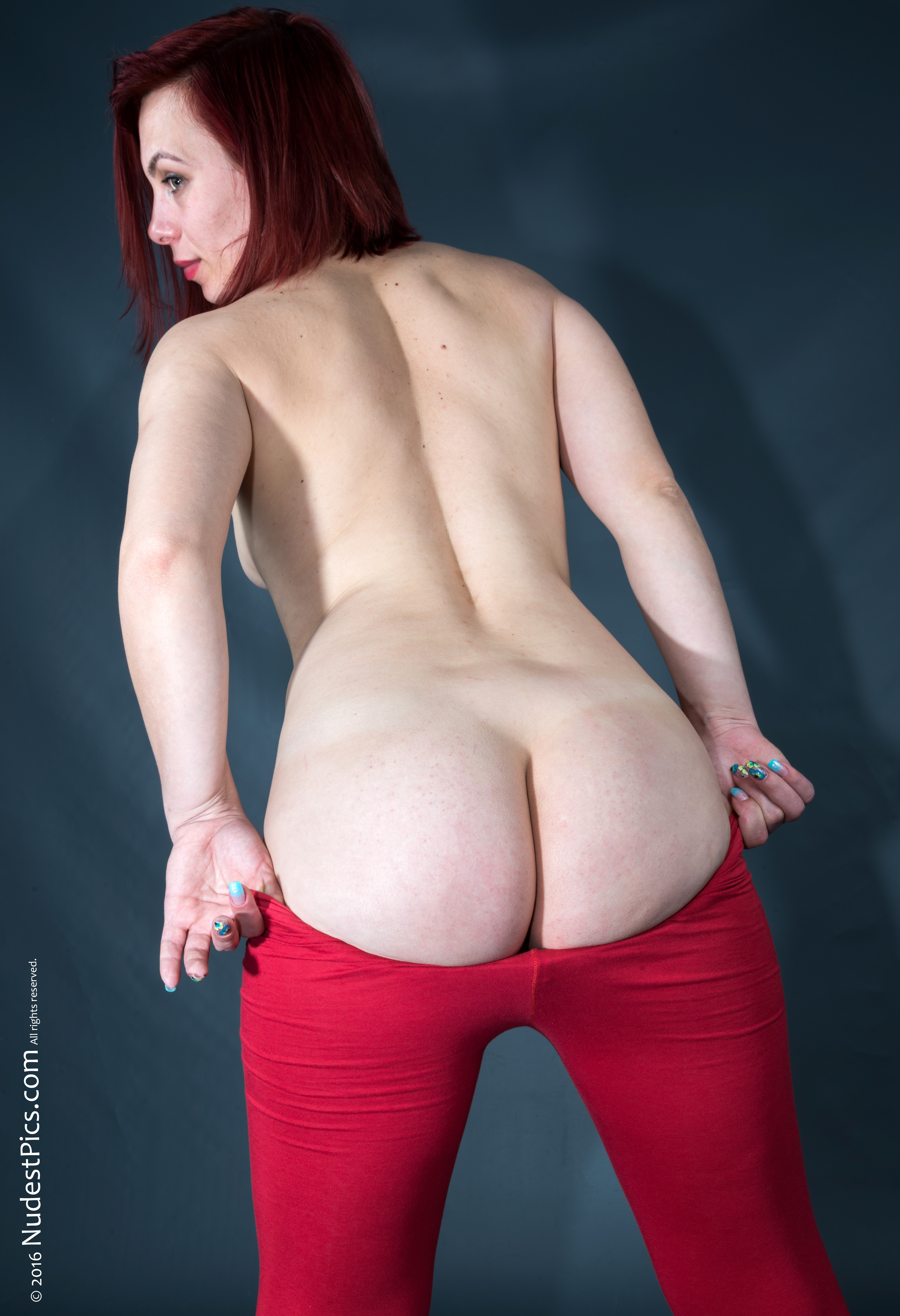 White Bubble Butt Girl Undressing Red Tights