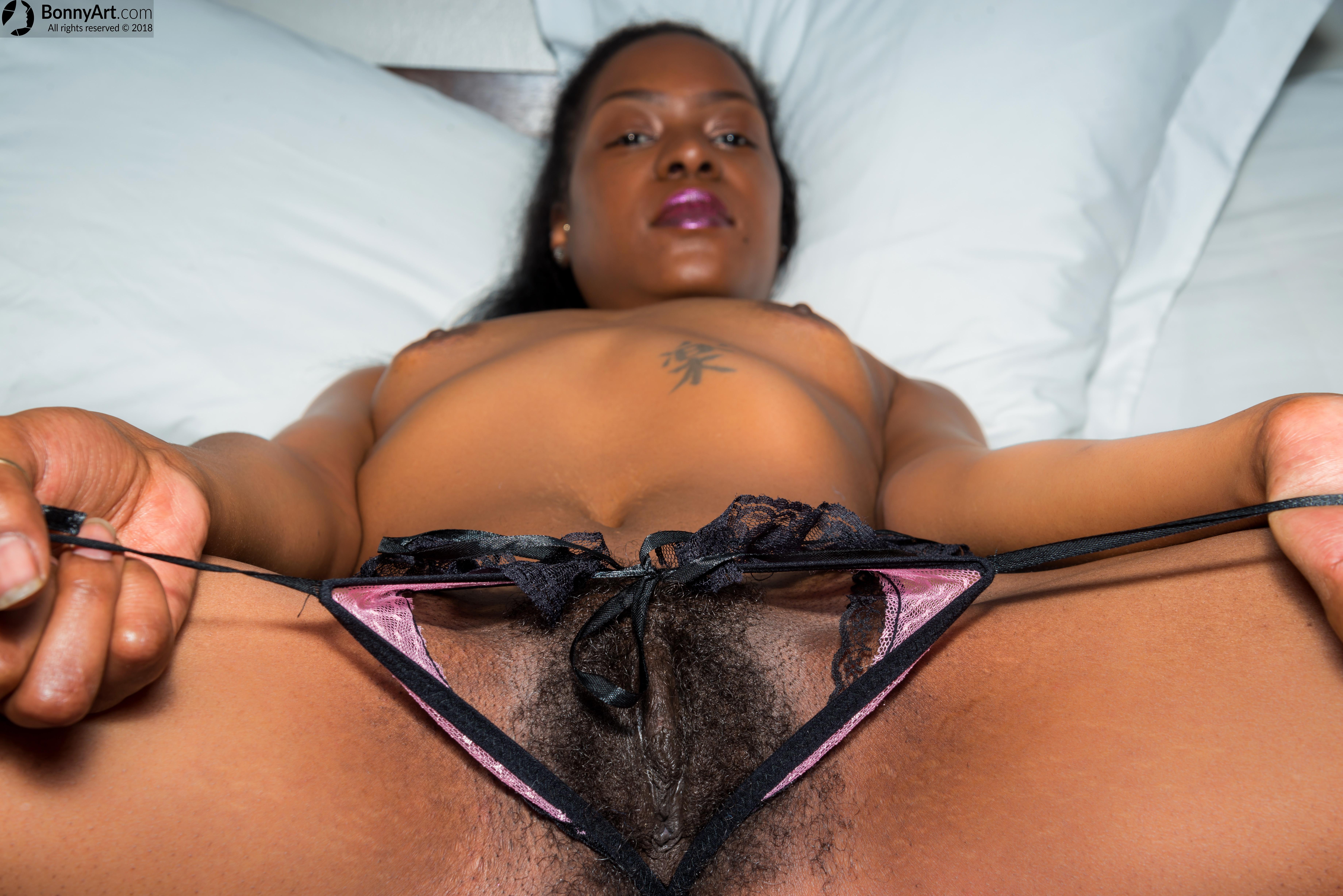Showing her Ebony Unshaven Vulva Crotchless Panties