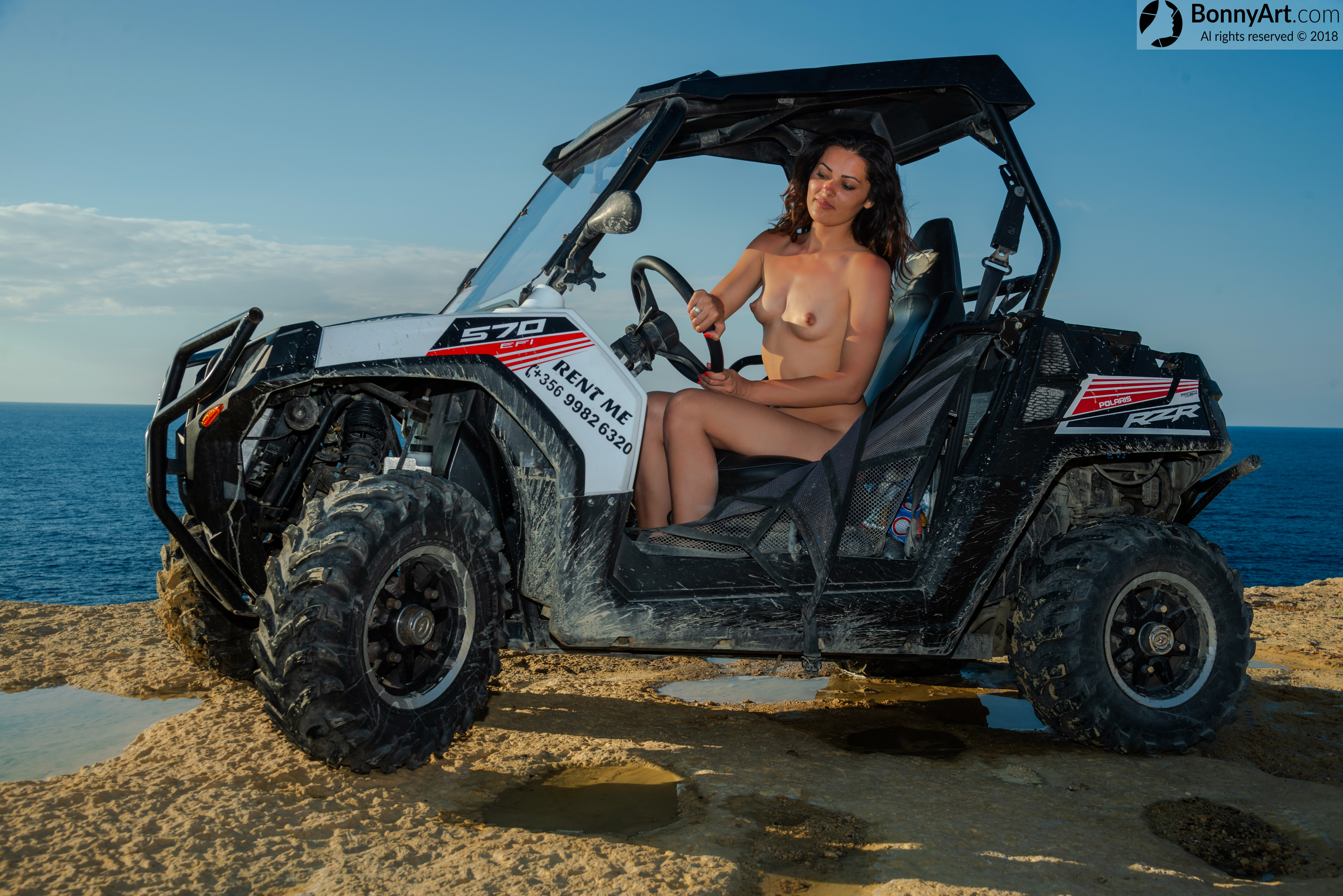 Nude Girl Driving Buggy Car on the Coast