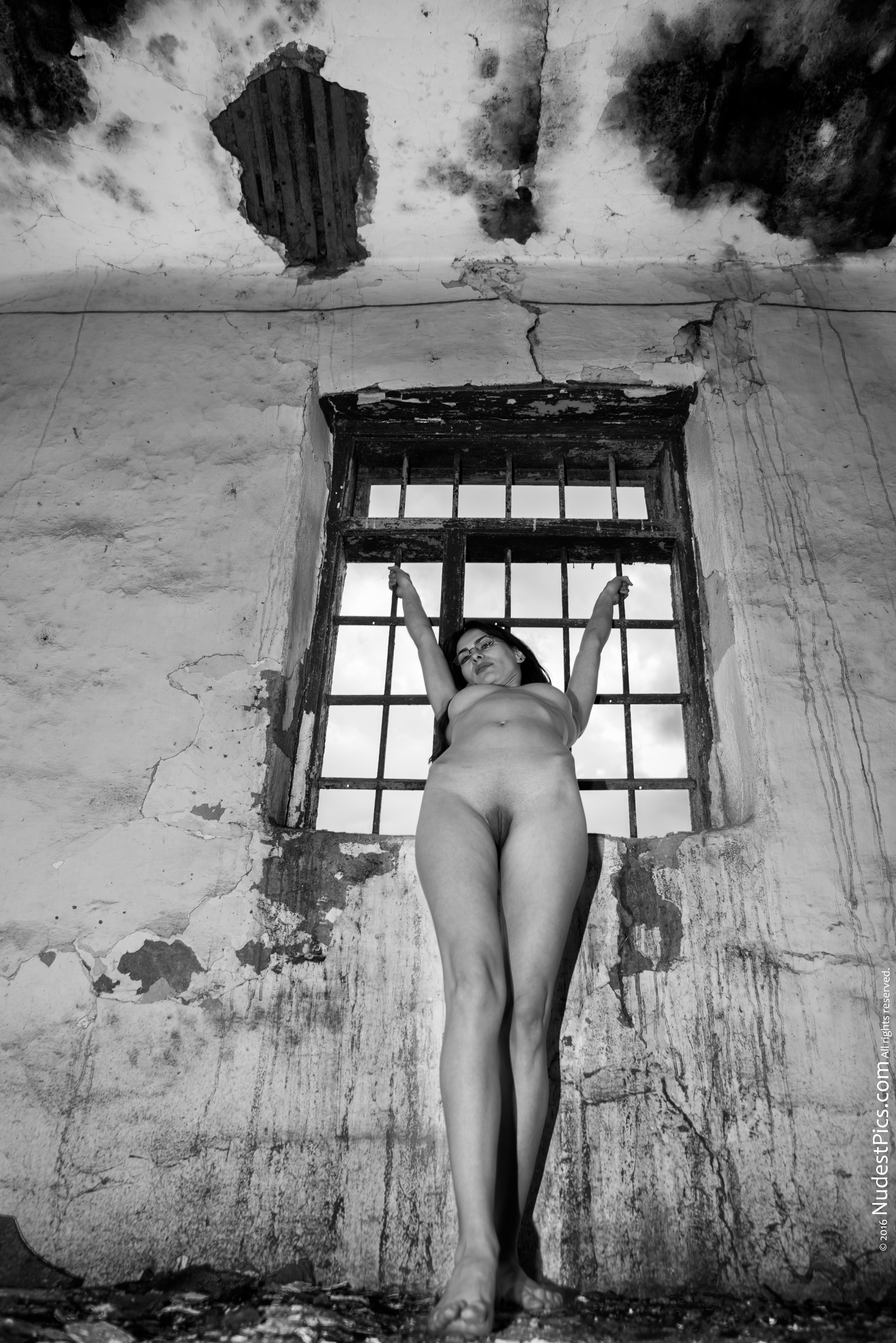Naked Nerdy Gal in Dirty Ravaged Old Prison B&W