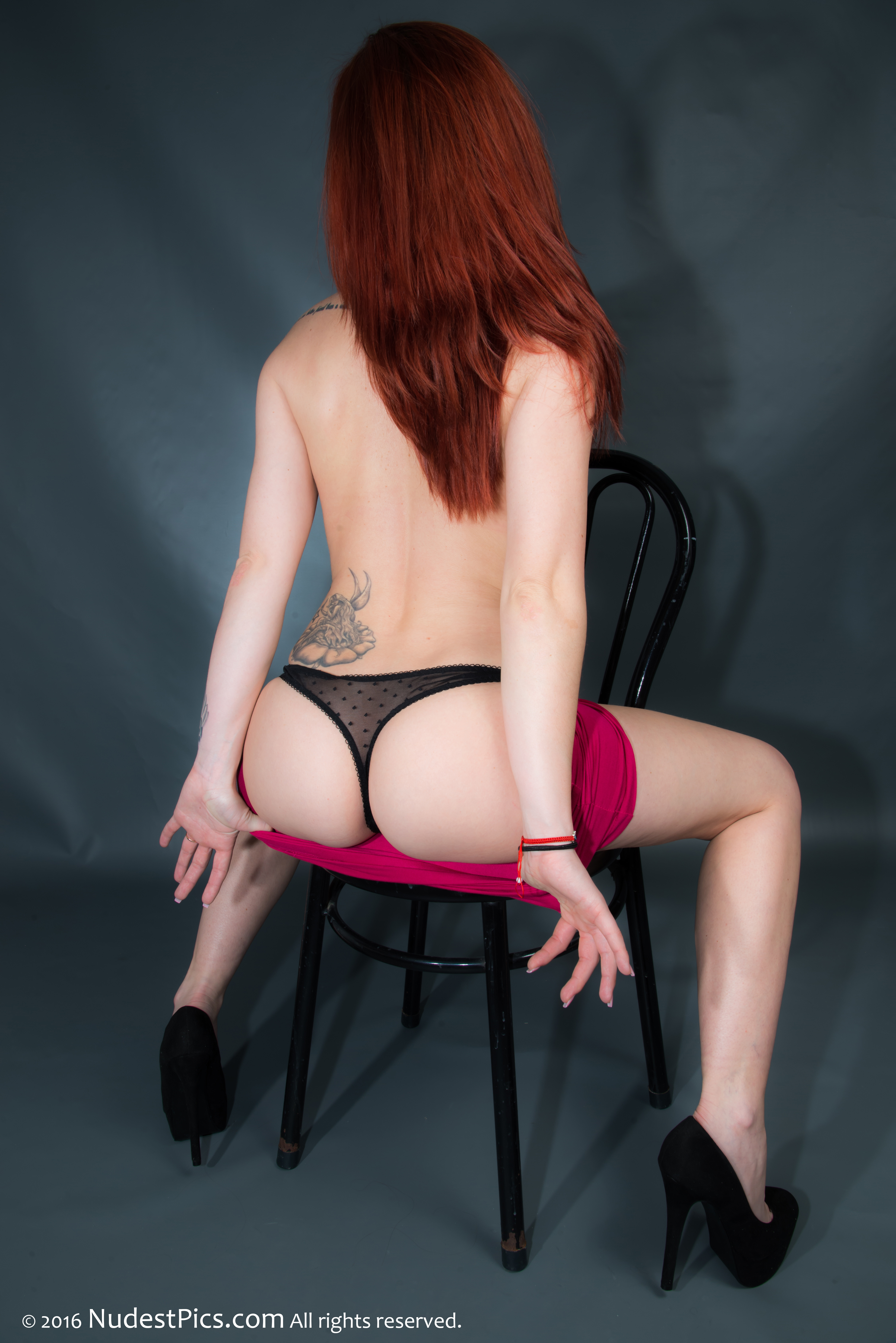 Redhead Hottie Uncovering Tattooed Back Sexy Thong